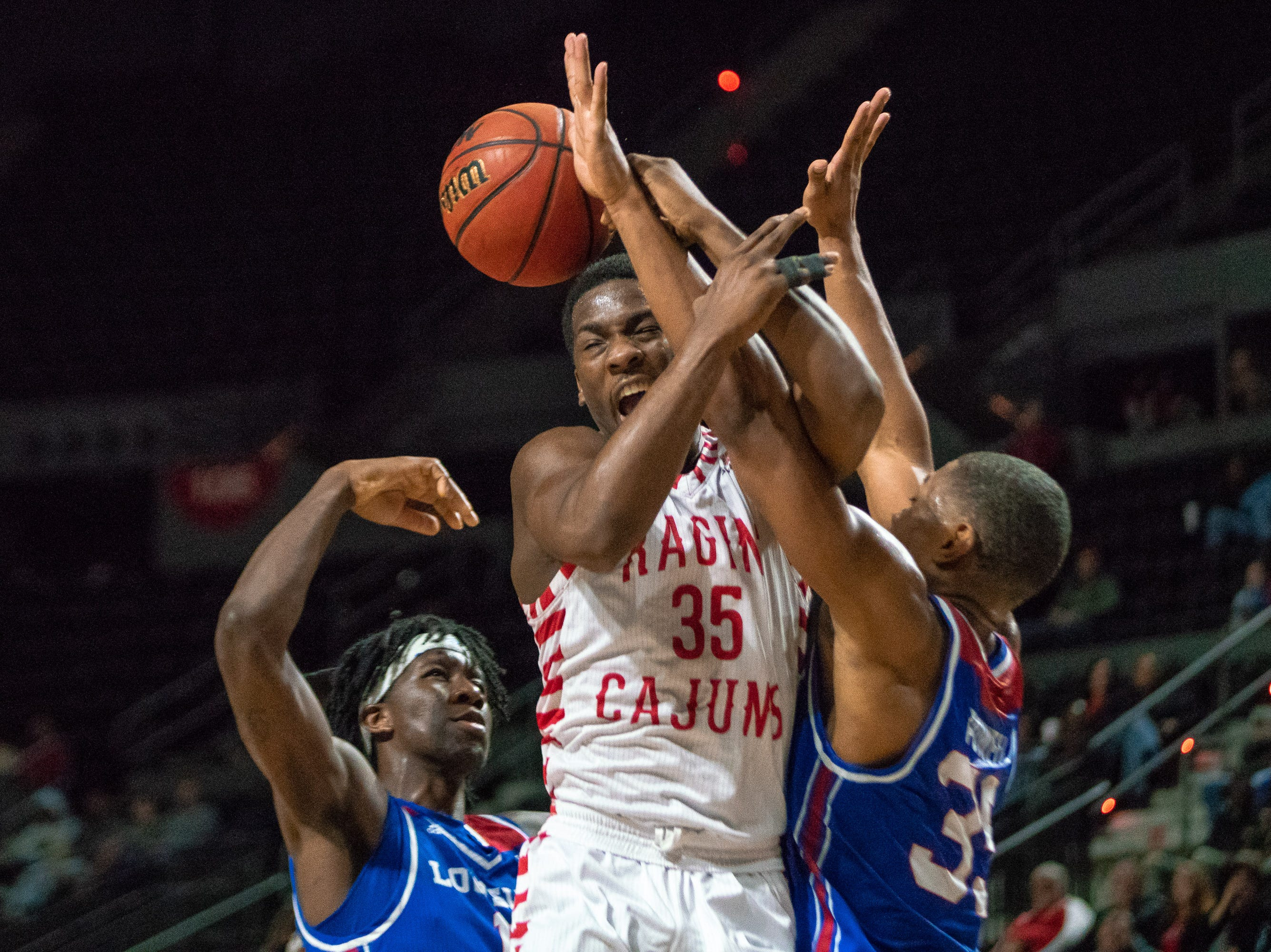 UL's Marcus Stroman gets fouled while going to the goal as the Ragin' Cajuns take on the LA Tech Bulldogs at the Cajundome on December 15, 2018.