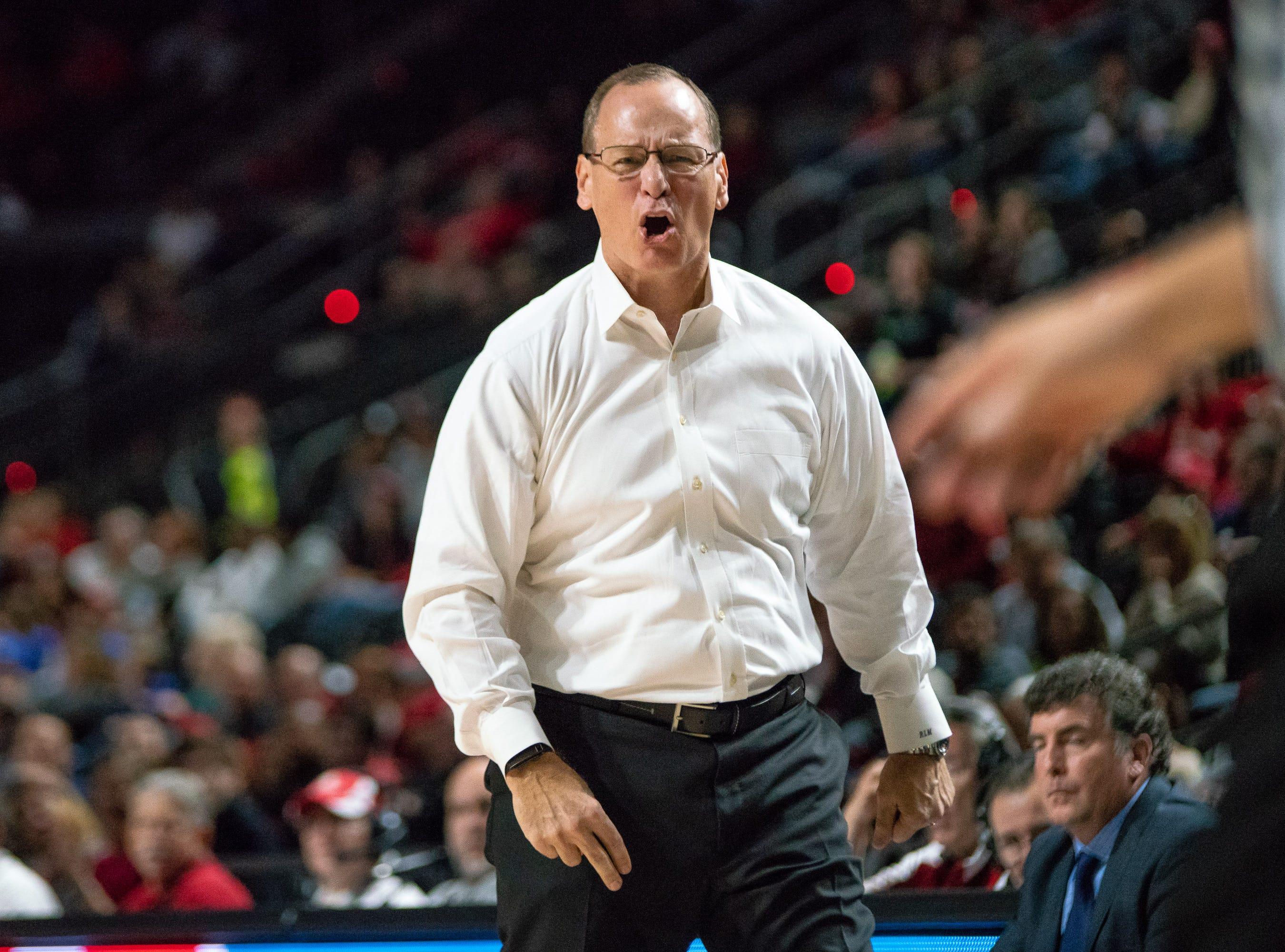 UL's head basketball coach Bob Marlin reacting negatively to a call as the Ragin' Cajuns take on the LA Tech Bulldogs at the Cajundome on December 15, 2018.