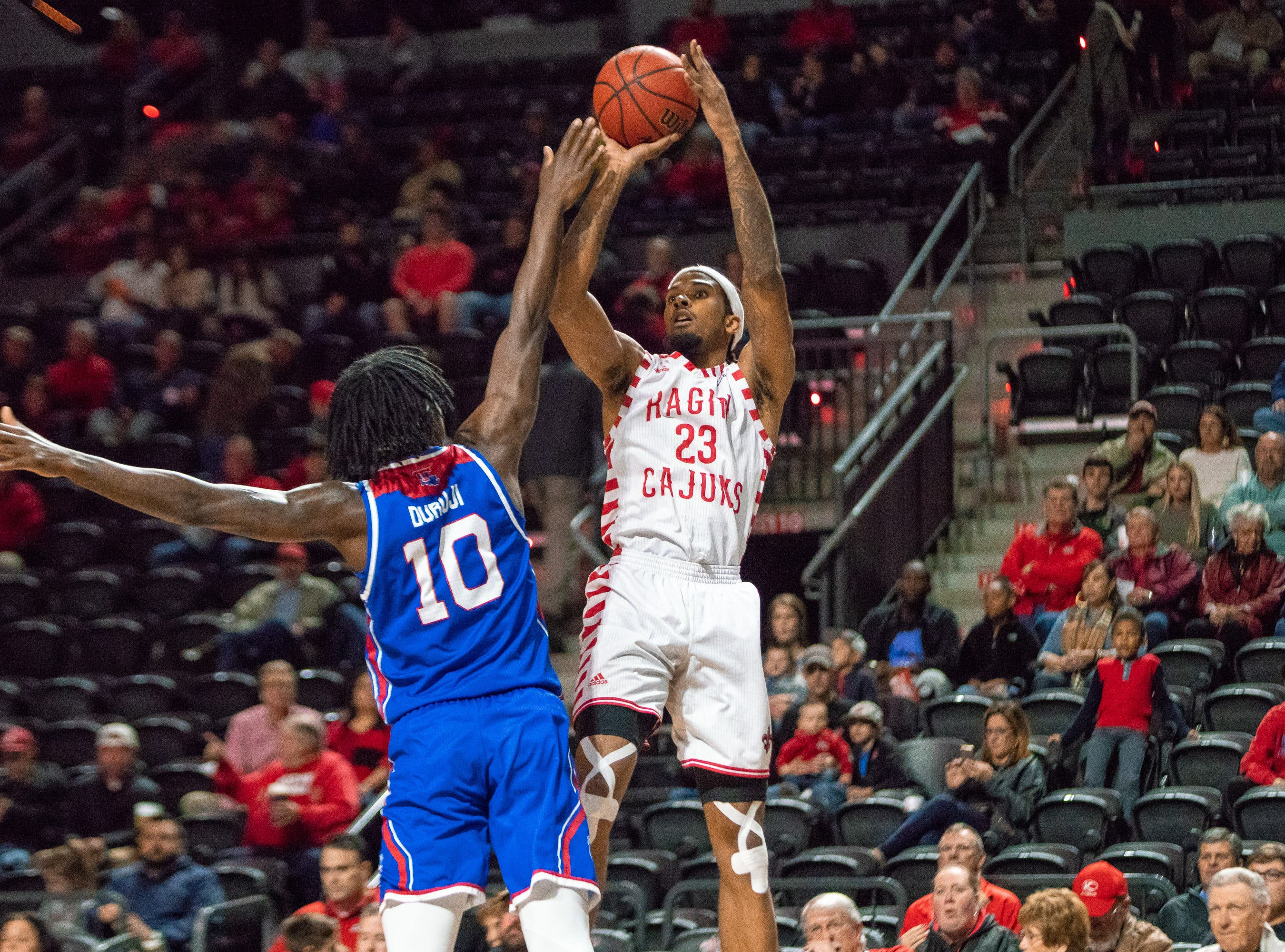 UL's Jakeenan Gant attempts to score a three-pointer as the Ragin' Cajuns take on the LA Tech Bulldogs at the Cajundome on December 15, 2018.