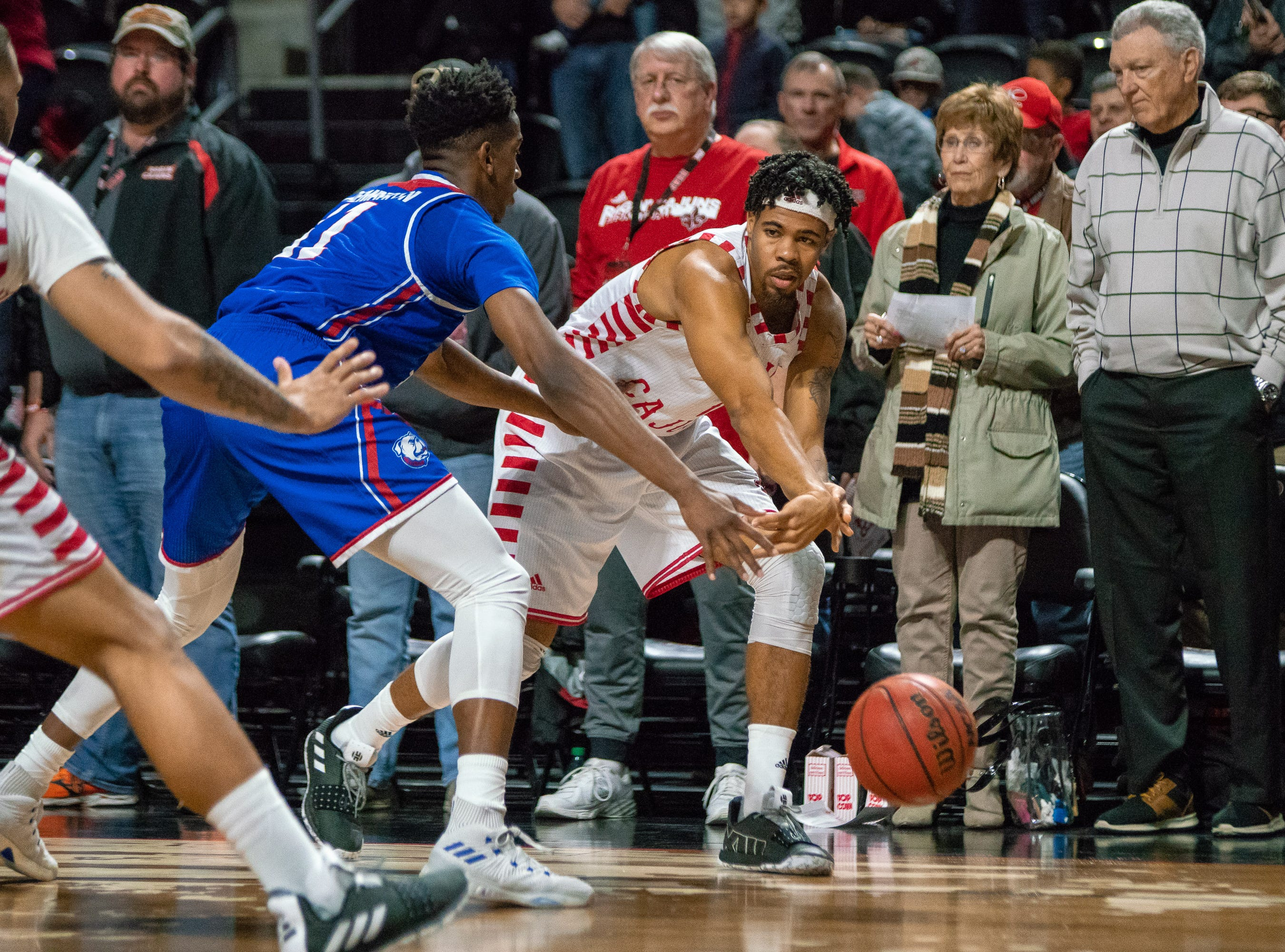 UL's Malik Marquetti passes the ball to his teammate as the Ragin' Cajuns take on the LA Tech Bulldogs at the Cajundome on December 15, 2018.