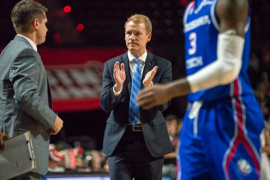 LA Tech's head basketball coach Eric Konkol applauds his team during the timeout as the Ragin' Cajuns take on the LA Tech Bulldogs at the Cajundome on December 15, 2018.