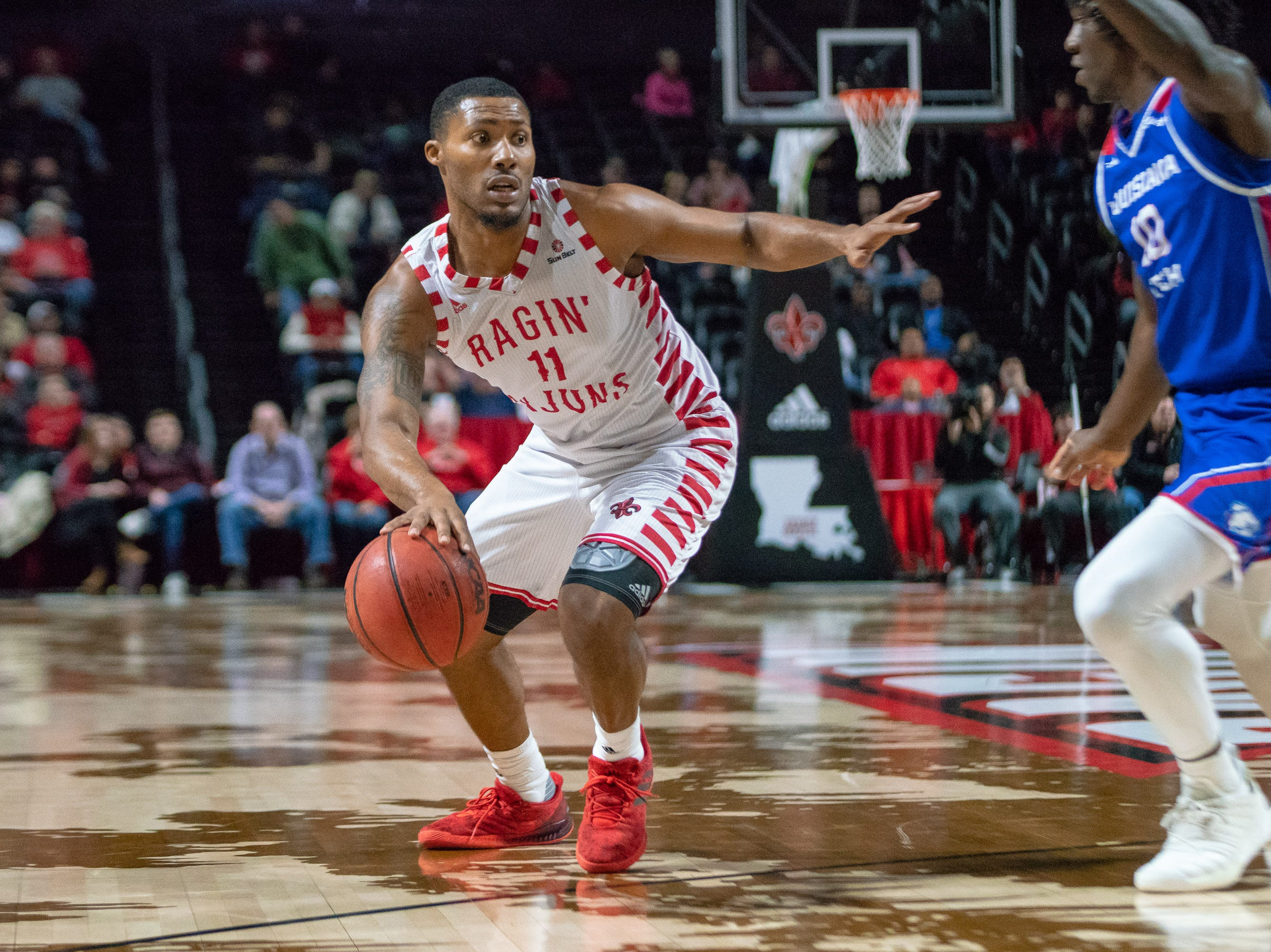 UL's Jerekius Davis drives to the goal as the Ragin' Cajuns take on the LA Tech Bulldogs at the Cajundome on December 15, 2018.