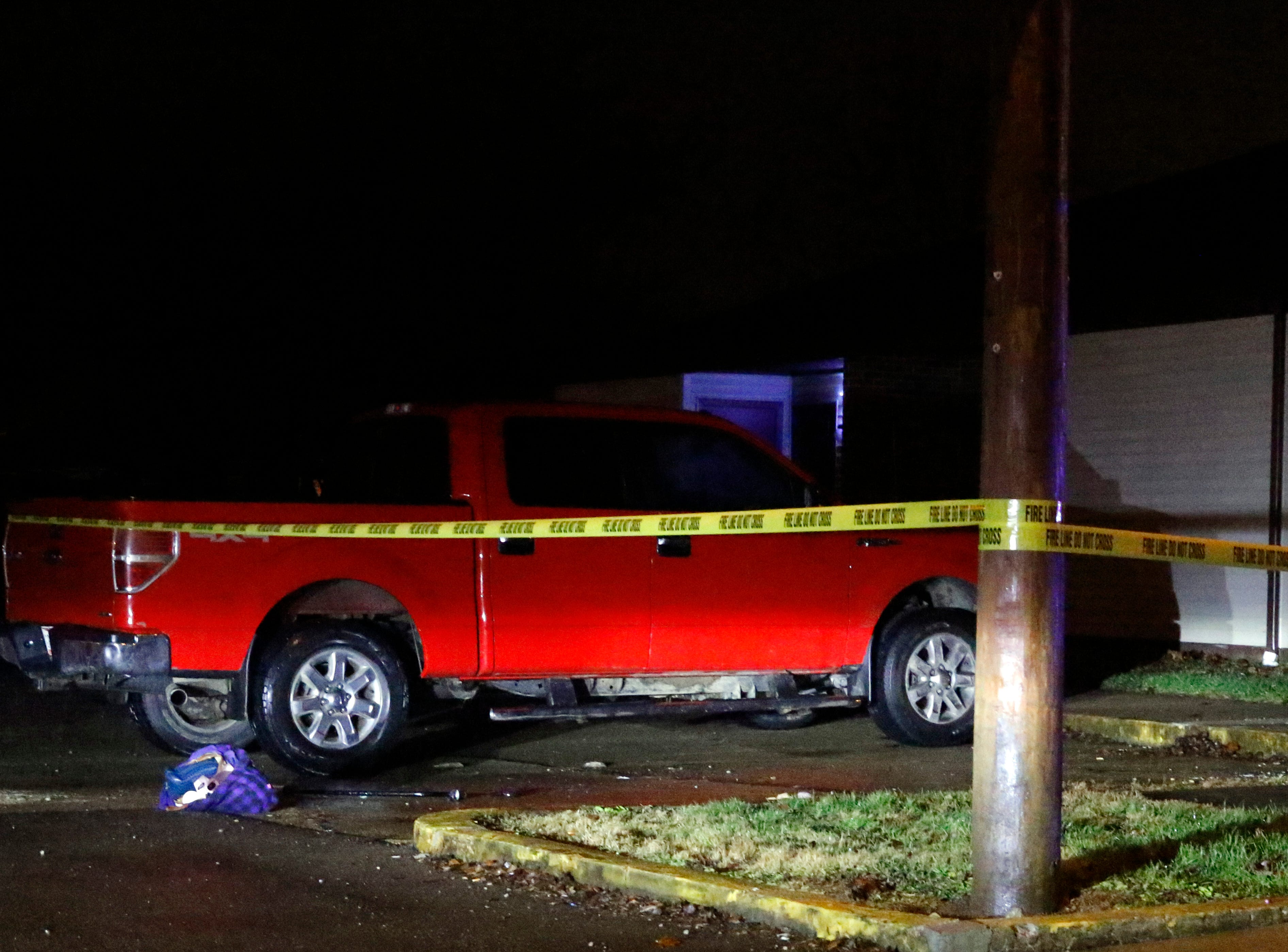 Yellow tape surrounds a truck at Lancaster Club Apartments Saturday night, Dec. 15, 2018, in Lancaster where a shooting took place.