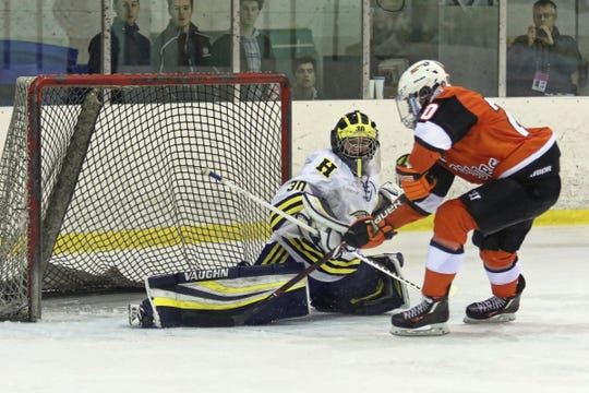 Hartland goalie Brett Tome makes a save on a shot by Chris Andoni in the Eagles' 5-1 victory over Birmingham Brother Rice on Saturday, Dec. 15, 2018.