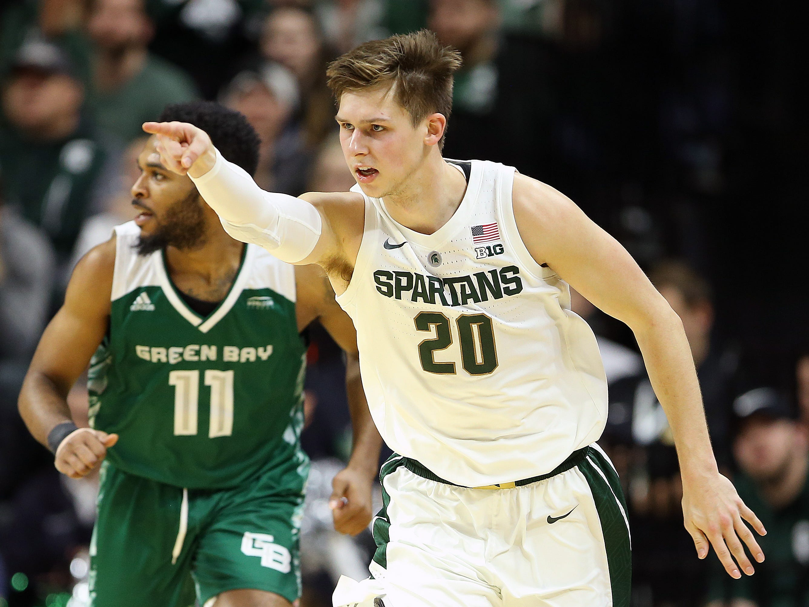 MSU guard Matt McQuaid reacts after hitting a 3-pointer in the first half of Sunday's MSU win over Green Bay at Breslin Center.