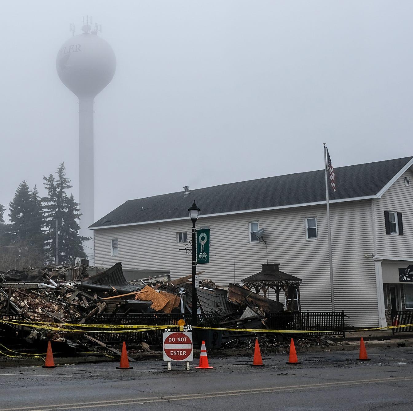 A sad but grateful Fowler cleans up after blaze destroys historic buildings