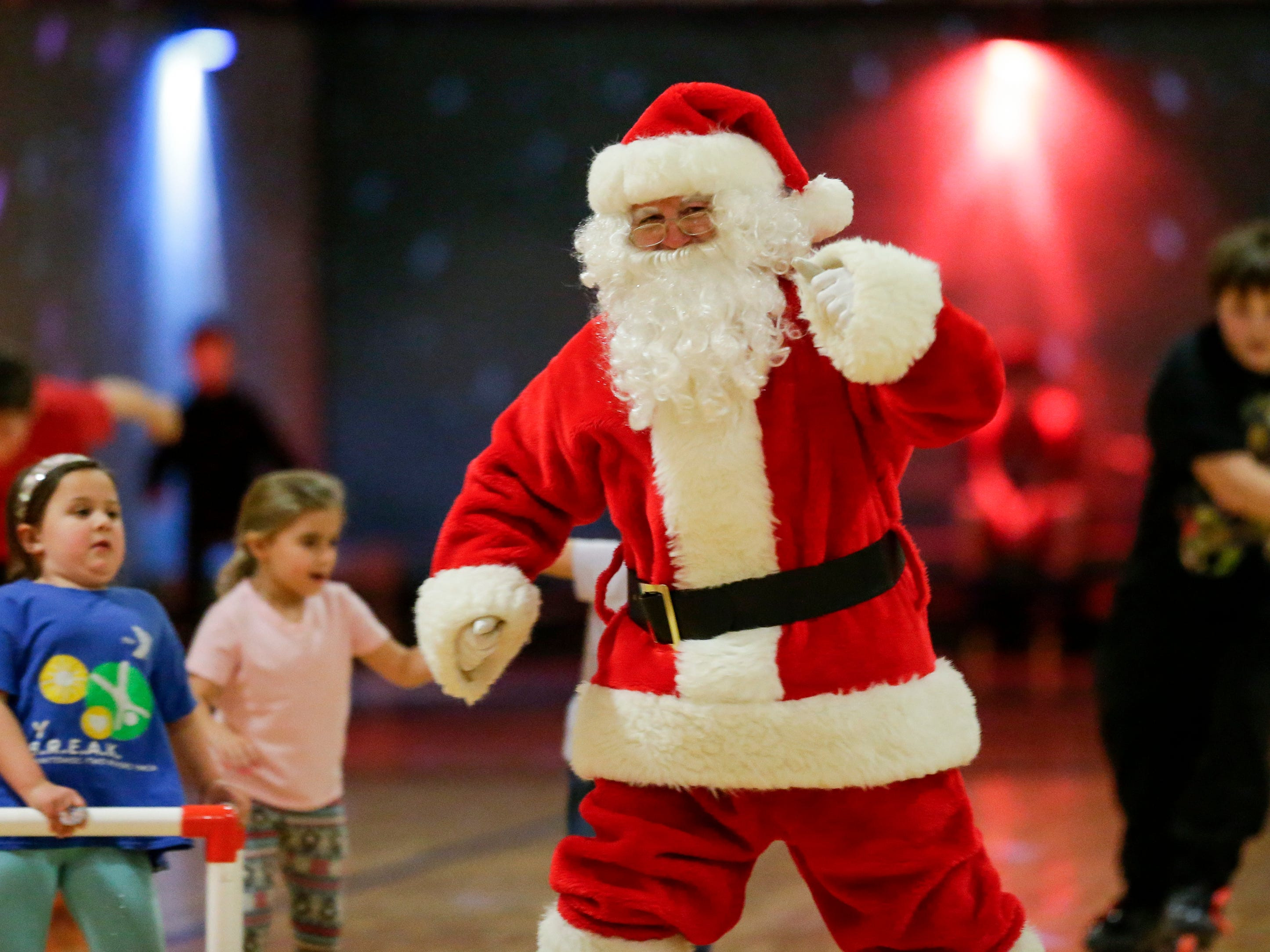 Santa dances during the 20th annual Santa Skate at Rollaire Skate Center Saturday, December 15, 2018, in Manitowoc, Wis. Joshua Clark/USA TODAY NETWORK-Wisconsin