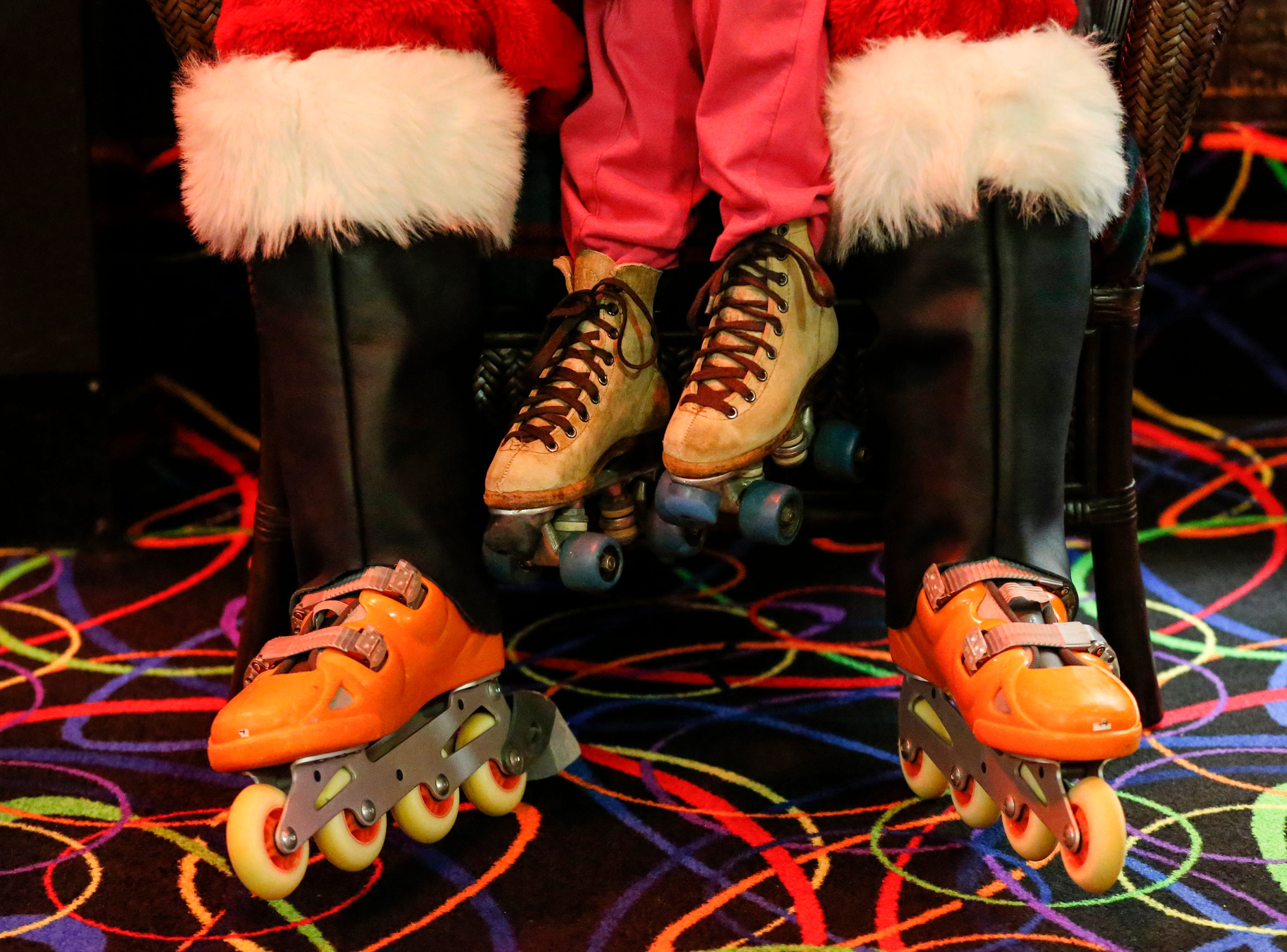 Santa sports orange inline skates as children take turns visiting with him during Santa Skate at Rollaire Skate Center Saturday, December 15, 2018, in Manitowoc, Wis. Joshua Clark/USA TODAY NETWORK-Wisconsin