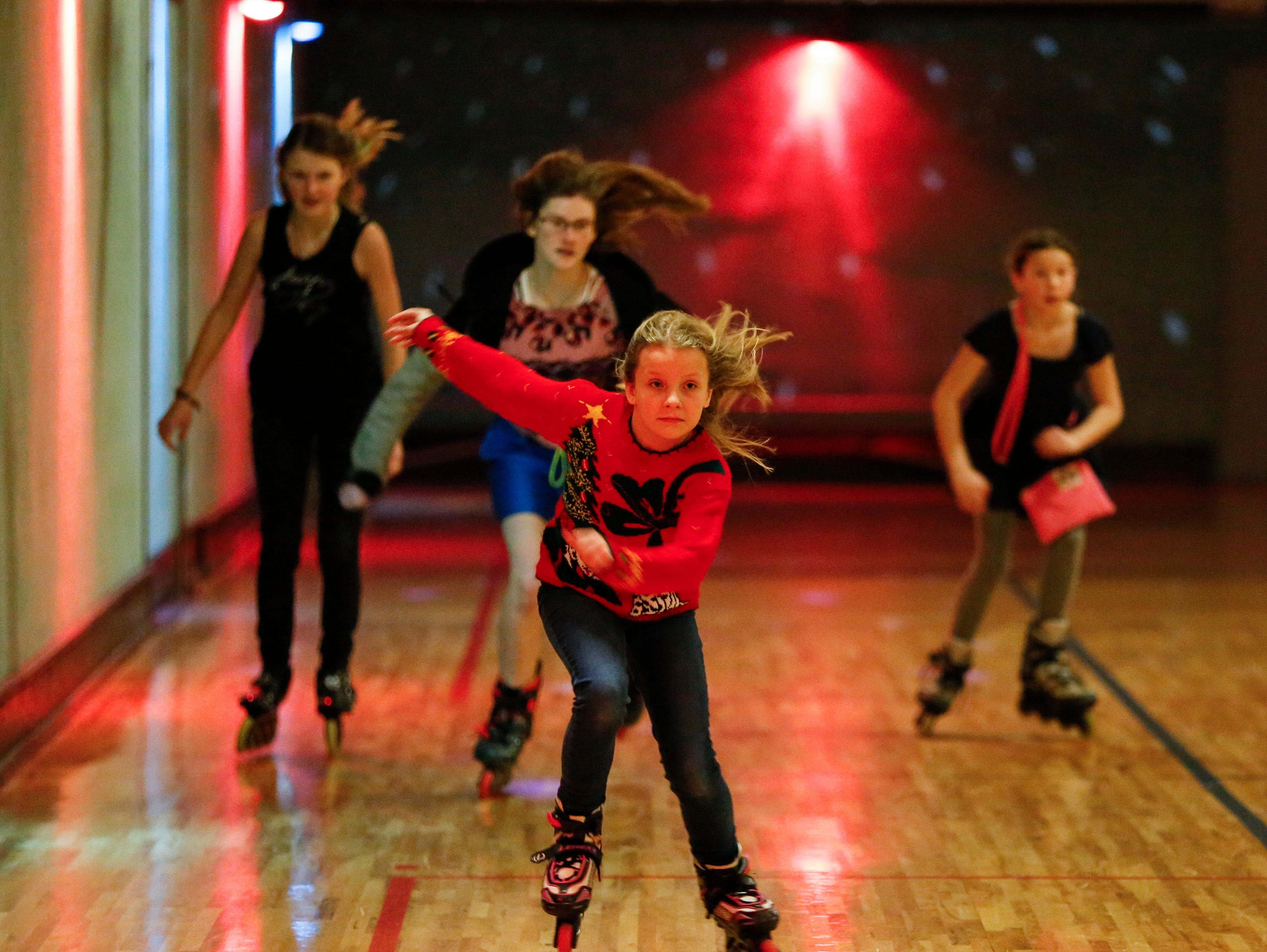 Jillian Hoffman, 11, leads the girls race during the 20th annual Santa Skate at Rollaire Skate Center Saturday, December 15, 2018, in Manitowoc, Wis. Joshua Clark/USA TODAY NETWORK-Wisconsin