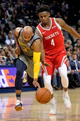 Memphis Grizzlies guard Jevon Carter (3) and Houston Rockets forward Danuel House Jr. (4) battle for control of the ball in the second half of an NBA basketball game Saturday, Dec. 15, 2018, in Memphis, Tenn. (AP Photo/Brandon Dill)