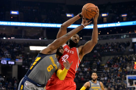 Houston Rockets center Nene Hilario (42) and Memphis Grizzlies guard Shelvin Mack (6) in the first half of on Saturday in Memphis.