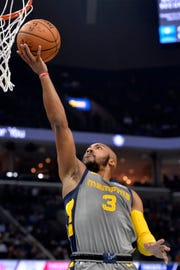 Grizzlies guard Jevon Carter had 11 points in his first NBA game Saturday against the Rockets.