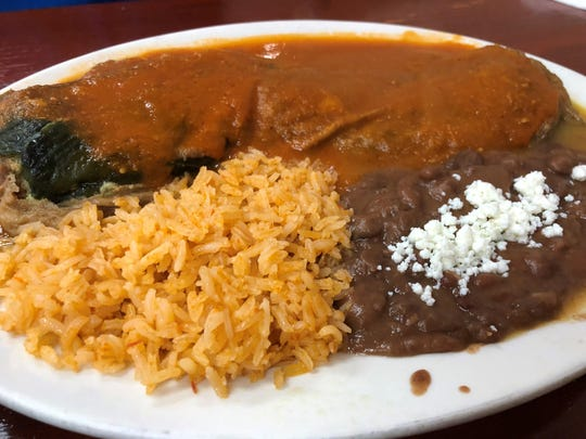 Chiles rellenos ($13.99), poblano peppers stuffed with cheese and topped with red sauce from Chilakil Mexican Grill & Tortilleria in East Naples.