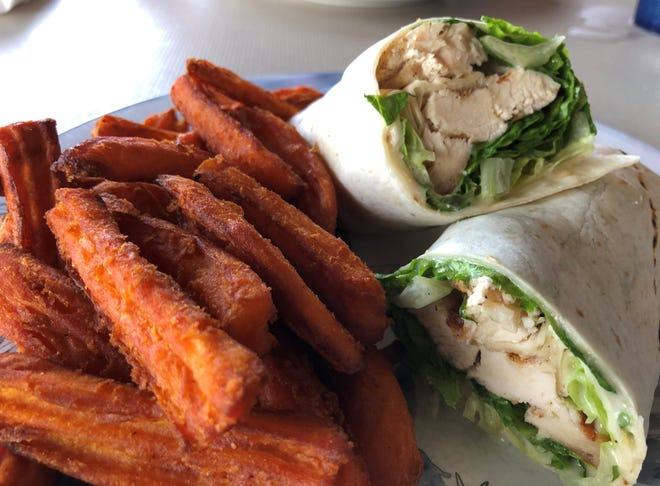 The chicken Cesar wrap and sweet potato fries from Capri Fish House.
