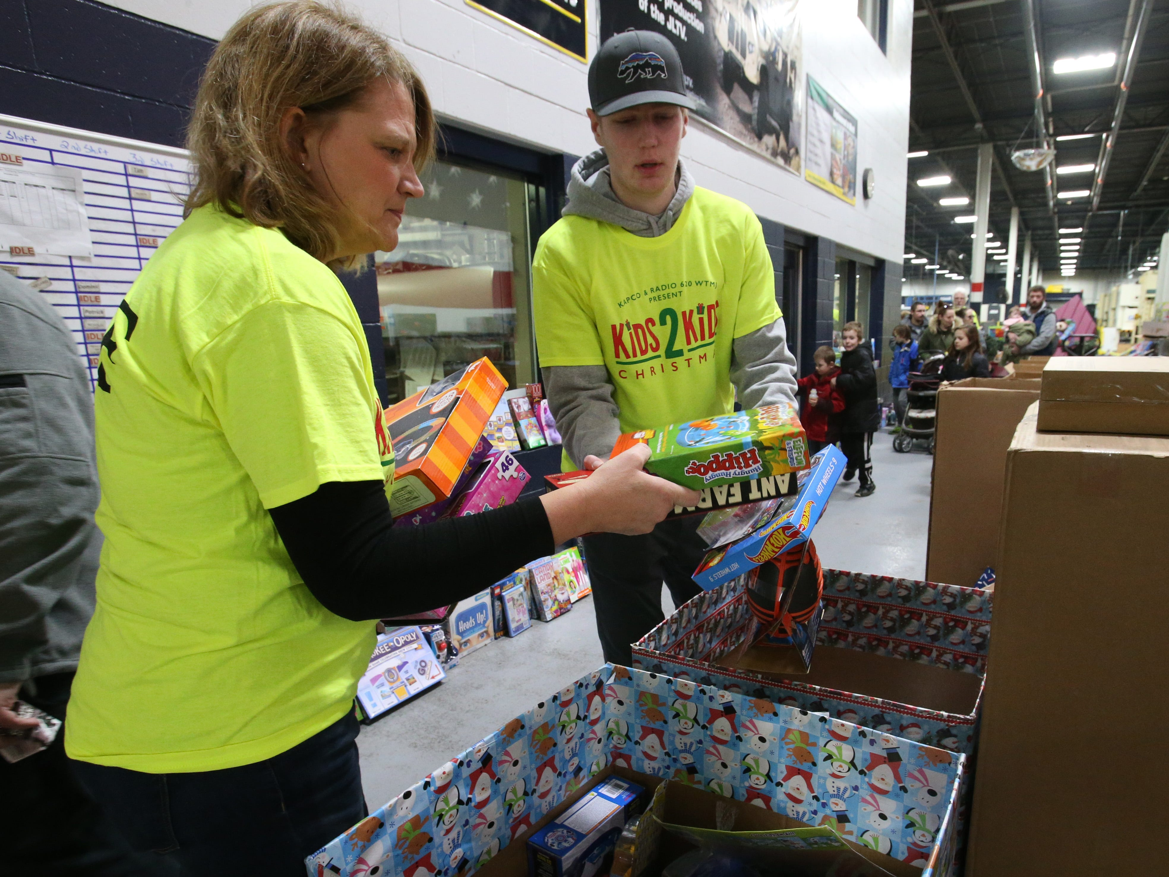Kathy Ebacher and Nick Johnson sort incoming toys at the Kids2Kids Christmas celebration at Kapco Metal Stamping in Grafton on Dec. 15 that concluded a month-long toy drive that collected more than 22,000 toys to be distributed to children in Ozaukee and Milwaukee counties.