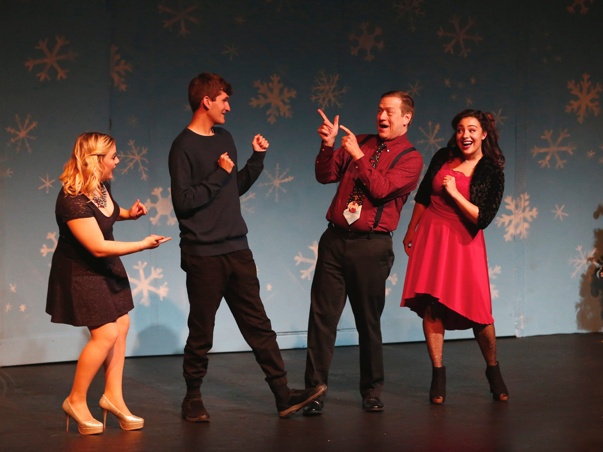 """Members of the ensemble sing """"Happy Holidays"""" in the first act of """"Candy Cane Tales and Holiday Carols"""" at Waukesha Civic Theatre on Dec. 14."""