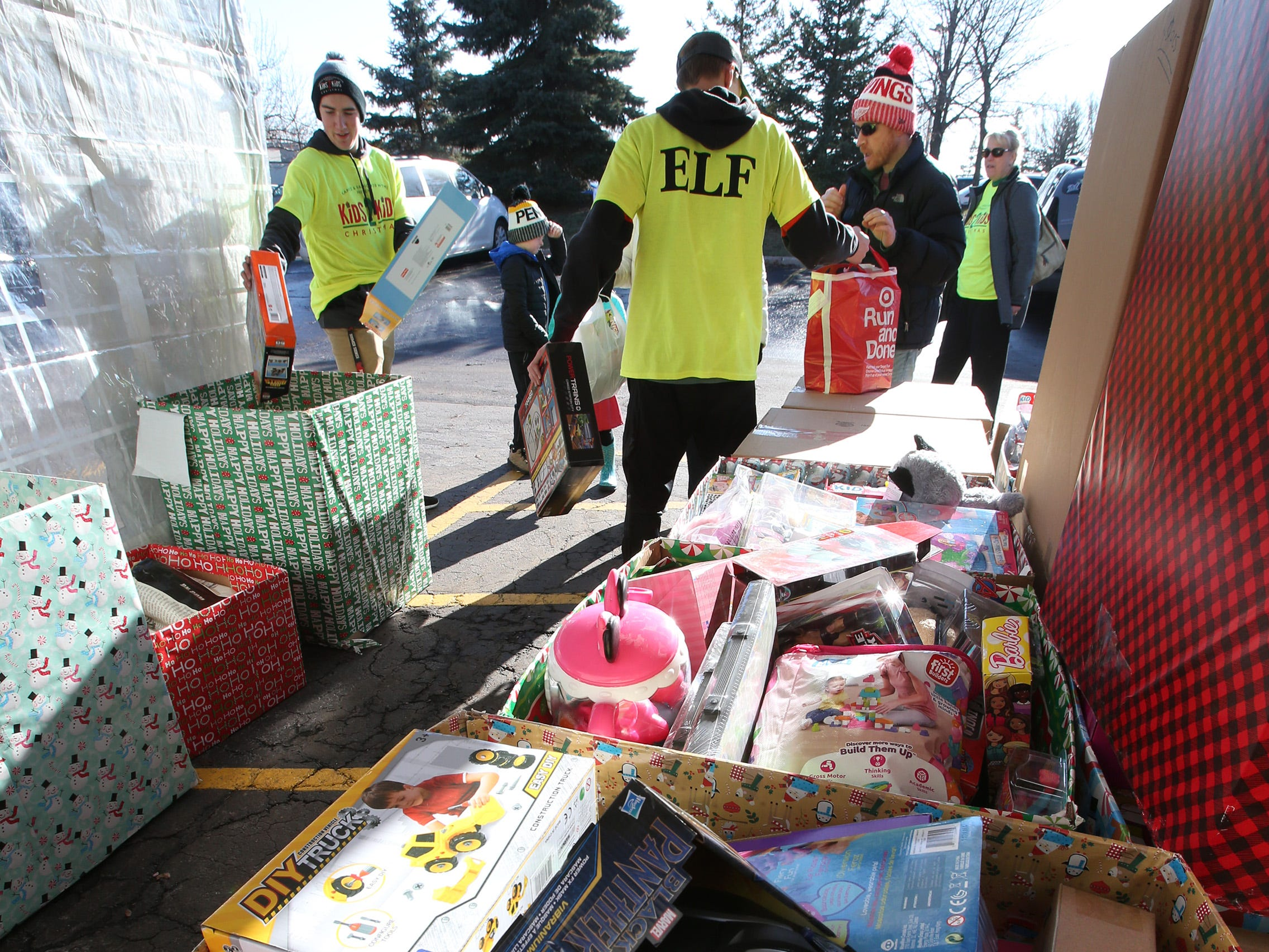 Ethan Ehlers and Tommy Lamb collect items in the drop-off area at the Kids2Kids Christmas celebration at Kapco Metal Stamping in Grafton on Dec. 15 that concluded a month-long toy drive that collected more than 22,000 toys to be distributed to children in Ozaukee and Milwaukee counties.