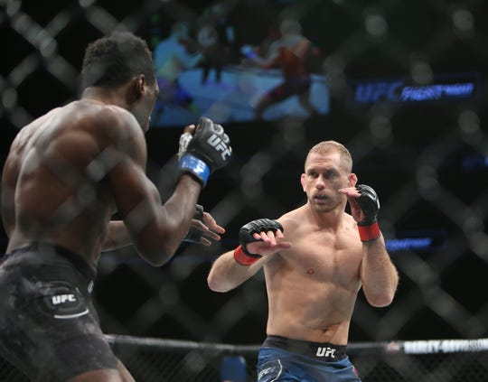 Milwaukee native Zak Ottow (red gloves) and Dwight Grant battle Saturday during UFC Fight Night at Fiserv Forum. Ottow, a fill-in on the card, was the only local fighter to win.