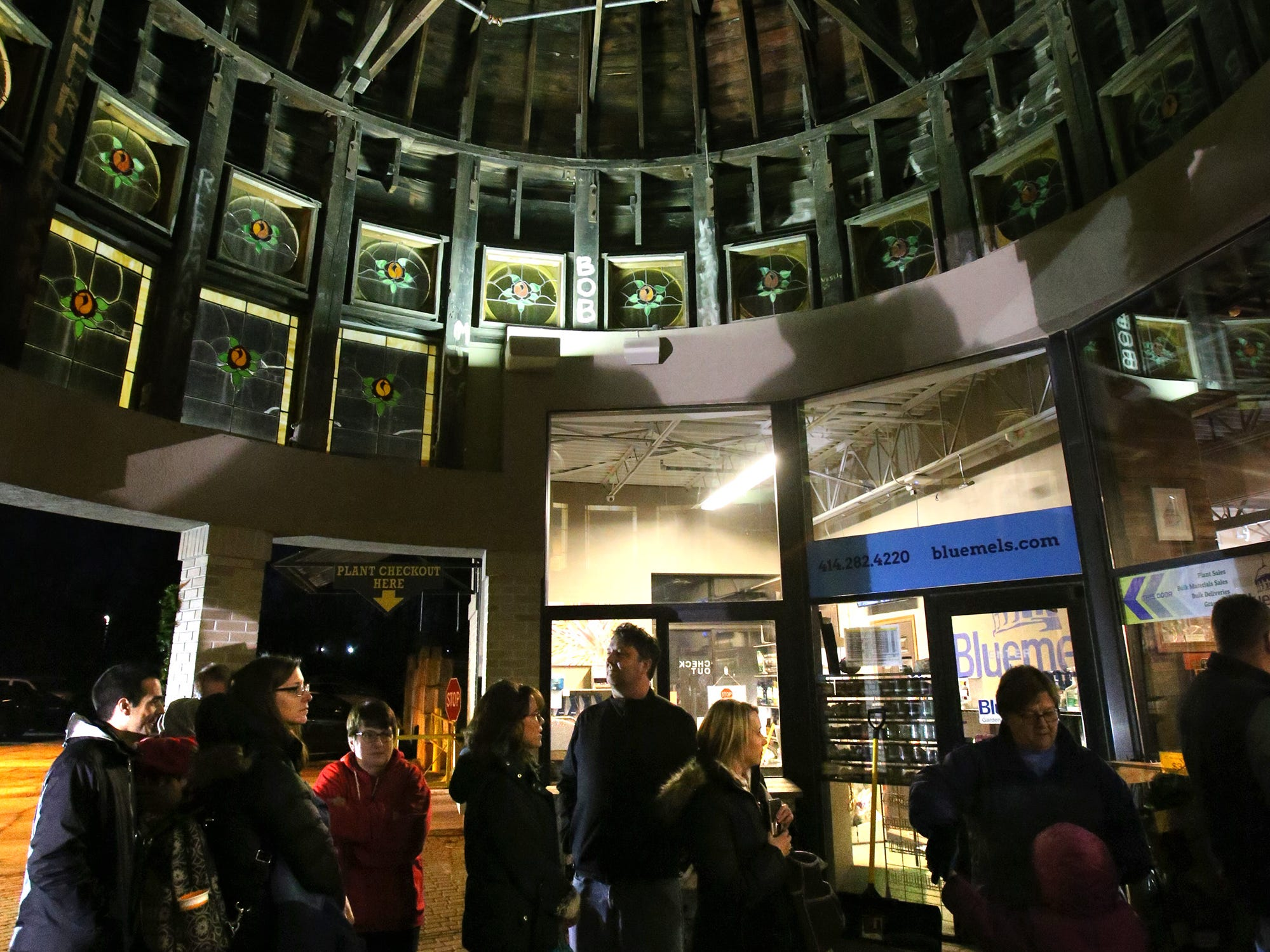 Families wait beneath the old South Division High School dome to enter Blum Coffee Garden for a visit with Santa at Bluemel's Garden and Landscape Center in Dec. 14.