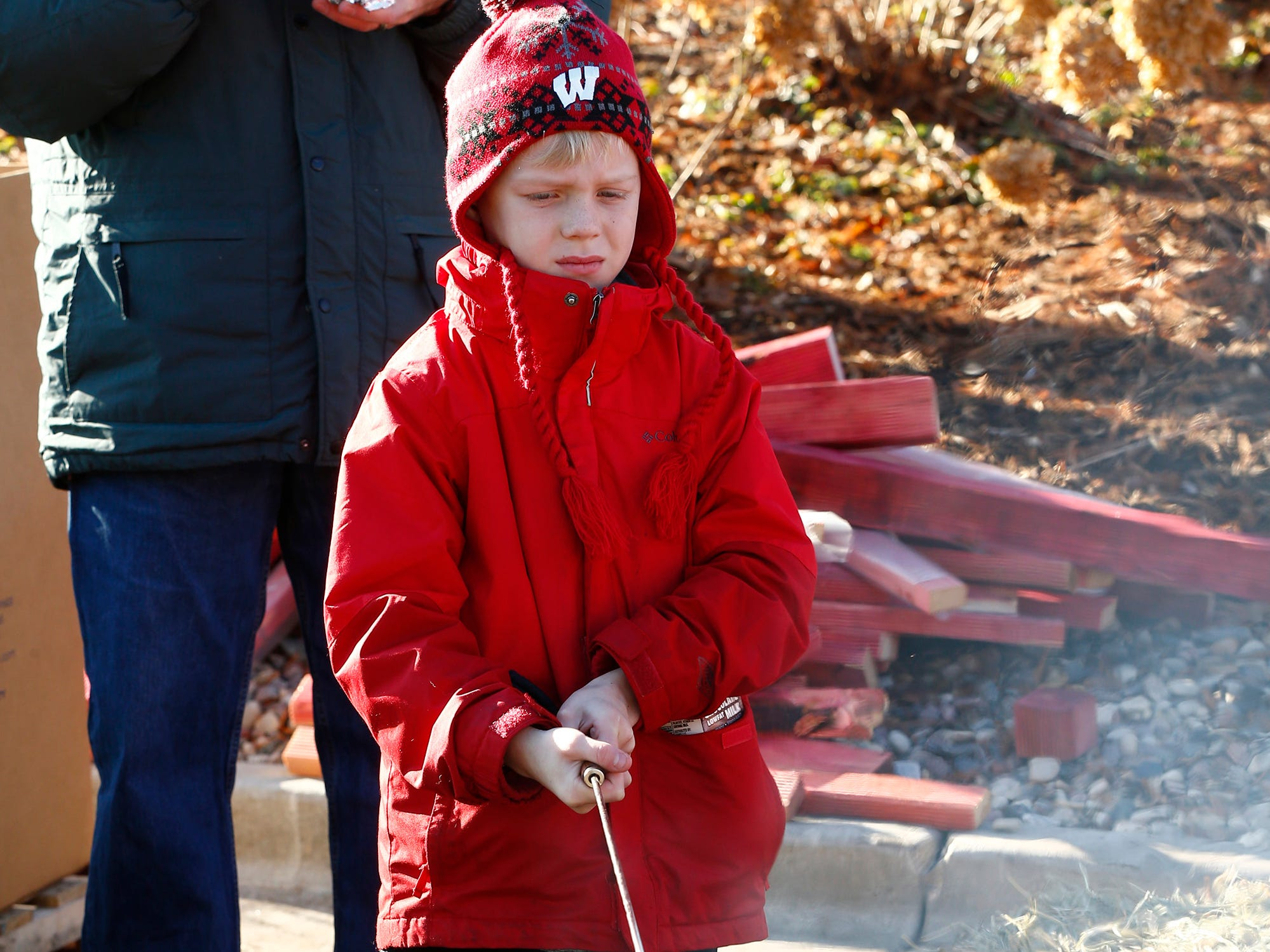 Jordy Hiller, 7, of Cedarburg roasts a marshmallow at the Kids2Kids Christmas celebration at Kapco Metal Stamping in Grafton on Dec. 15 that concluded a month-long toy drive that collected more than 22,000 toys to be distributed to children in Ozaukee and Milwaukee counties.