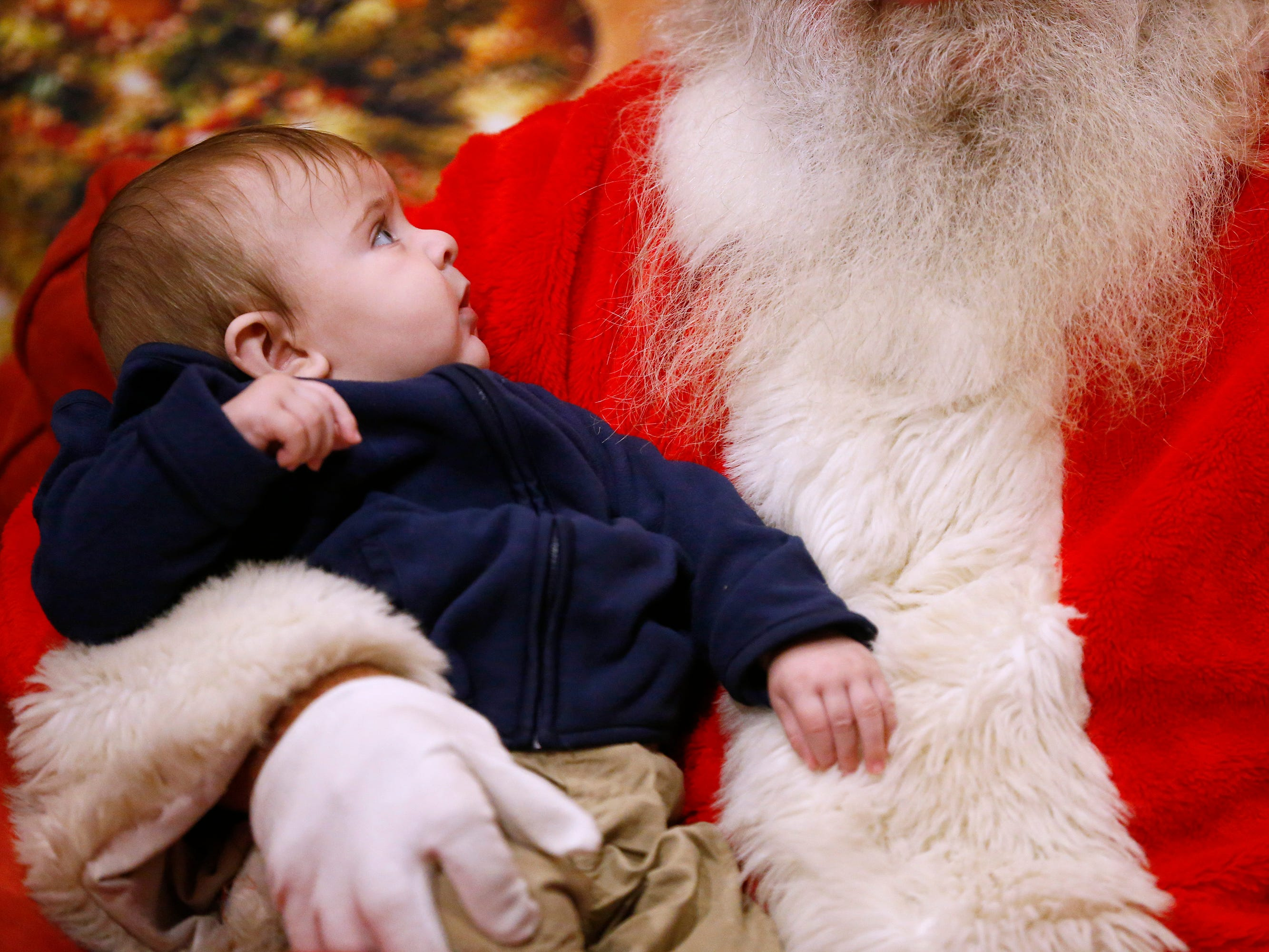 Max Tousey, 5 months, sits for his first time with Santa at Blum Coffee Garden during a visit with Santa and friends  at Bluemel's Garden and Landscape Center in Dec. 14.