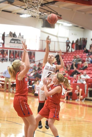 Norfork's Whitlee Layne shoots during the Lady Panthers' 67-61 loss to Melbourne on Saturday in the Billy Ply Classic at Flippin.