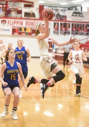 Flippin's Leah Still goes up for a layup Saturday morning against Kingston.