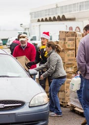 The News-Star's Goodfellows program distributed boxes of food on Saturday.