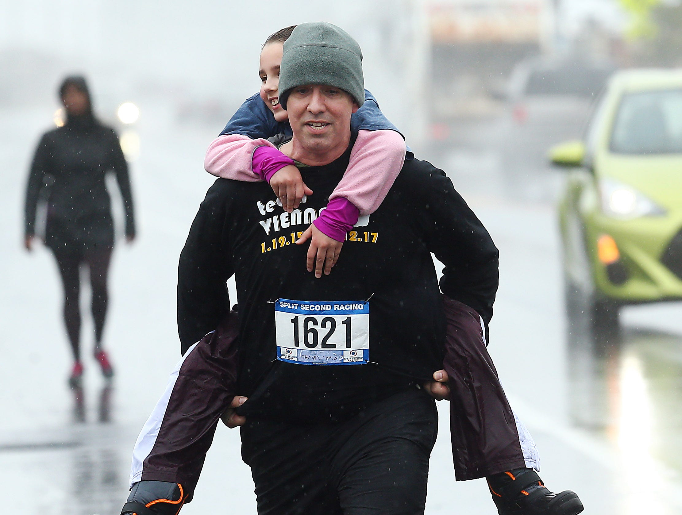 Michael Savino runs with his daughter on his back, running for Team Vienna for SUDC Awareness joined Run With the Royals 5K in Sea Bright to honor Vienna Savino to raise awareness for Sudden Unexplained Death in Childhood, a tragic and little known cause of death in children. May 19, 2018. Sea Bright, NJ