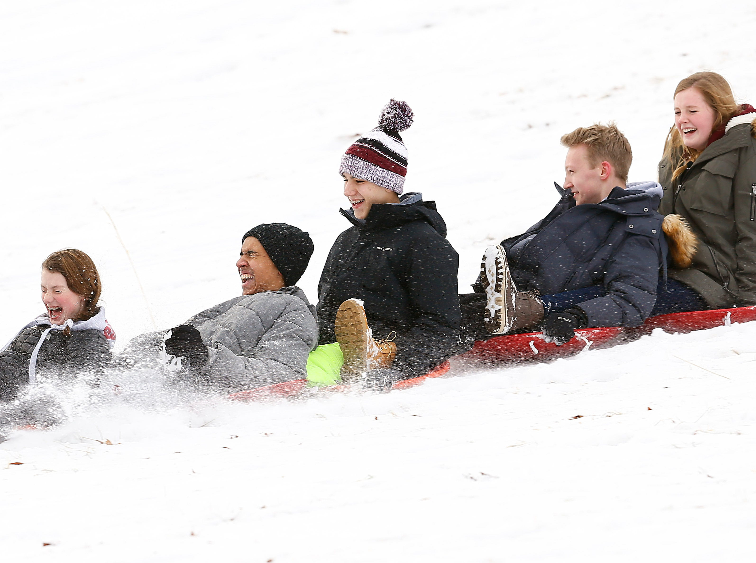 Five friends from Morristown flys down Villa Walsh Hill as children and their parents enjoy a day off from school sledding in Morristown after the area received about 4 inches of snow. January 17, 2018. Morristown, NJ.