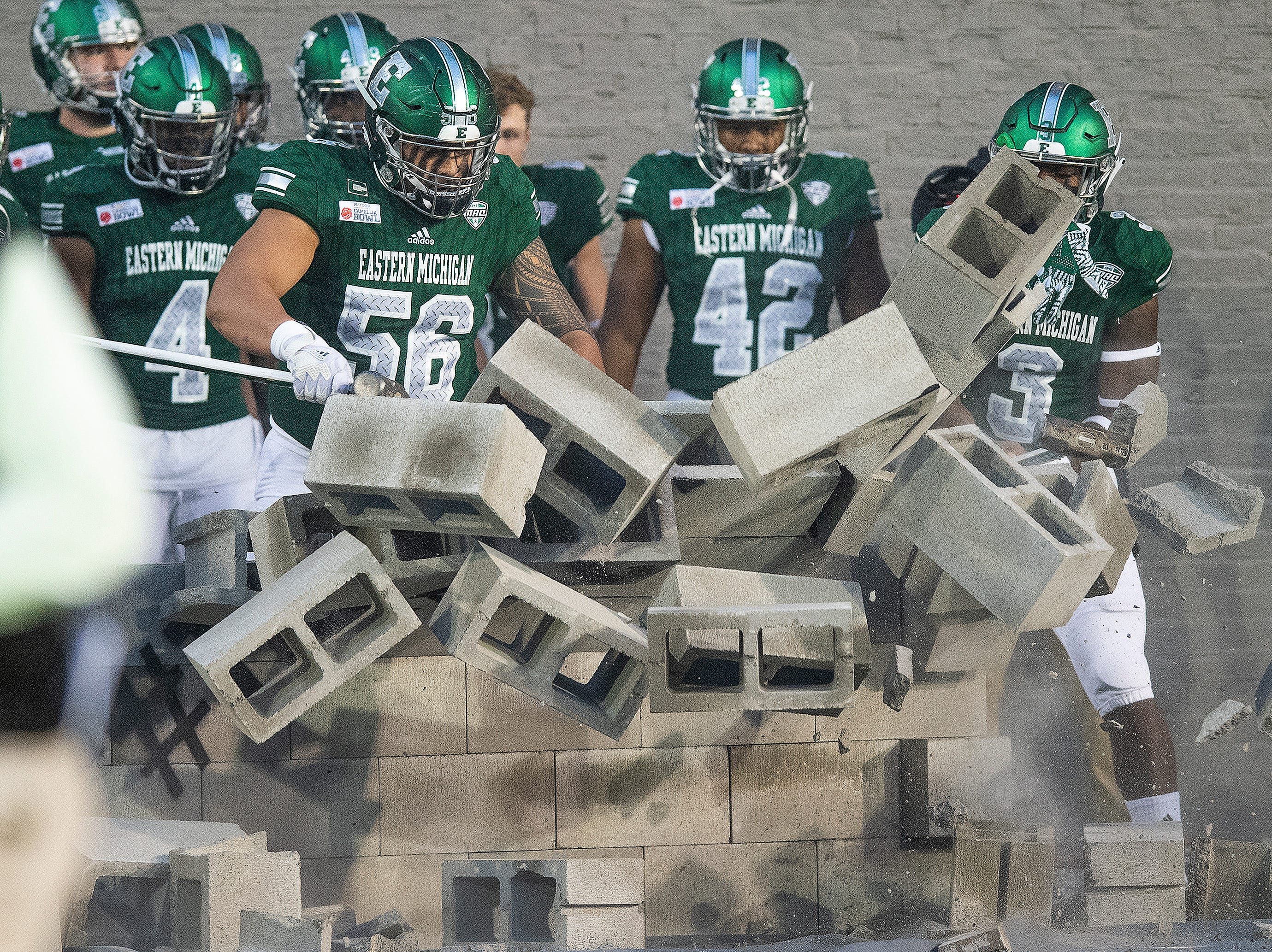 Eastern Michigan comes through a wall as they take the field for the Raycom Media  Camellia Bowl held at Cramton Bowl in Montgomery, Ala., on Saturday December 15, 2018.