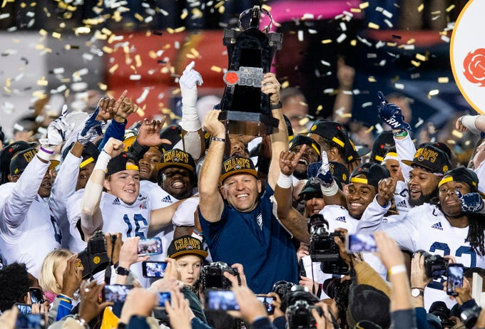 Georgia Southern head coach Chad Lunsford  lifts the trophy after defeating Eastern Michigan with a last second field goal in the Raycom Media  Camellia Bowl held at Cramton Bowl in Montgomery, Ala., on Saturday December 15, 2018.