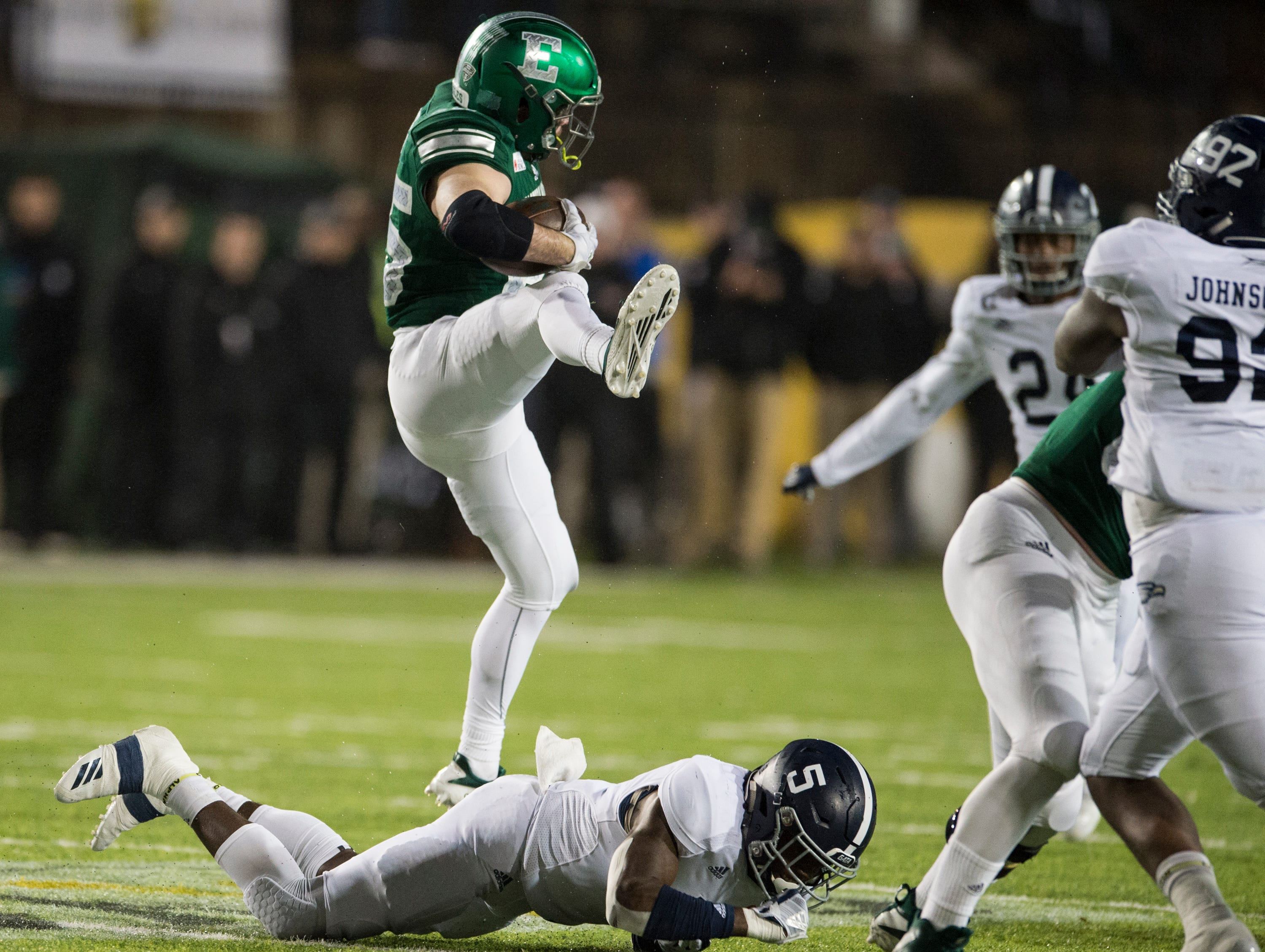 Eastern Michigan running back Ian Eriksen (25) hurdles Georgia Southern safety Jay Bowdry (5) during the Camellia Bowl at Cramton Bowl in Montgomery, Ala., on Saturday, Dec. 15, 2018. Georgia Southern defeated Eastern Michigan 23-21.