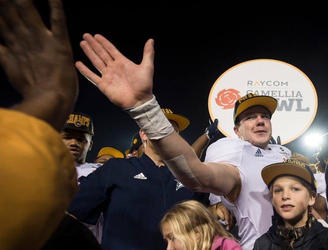 Georgia Southern placekicker Tyler Bass (16) high fives a fan during the trophy presentation after the Camellia Bowl at Cramton Bowl in Montgomery, Ala., on Saturday, Dec. 15, 2018. Georgia Southern defeated Eastern Michigan 23-21.