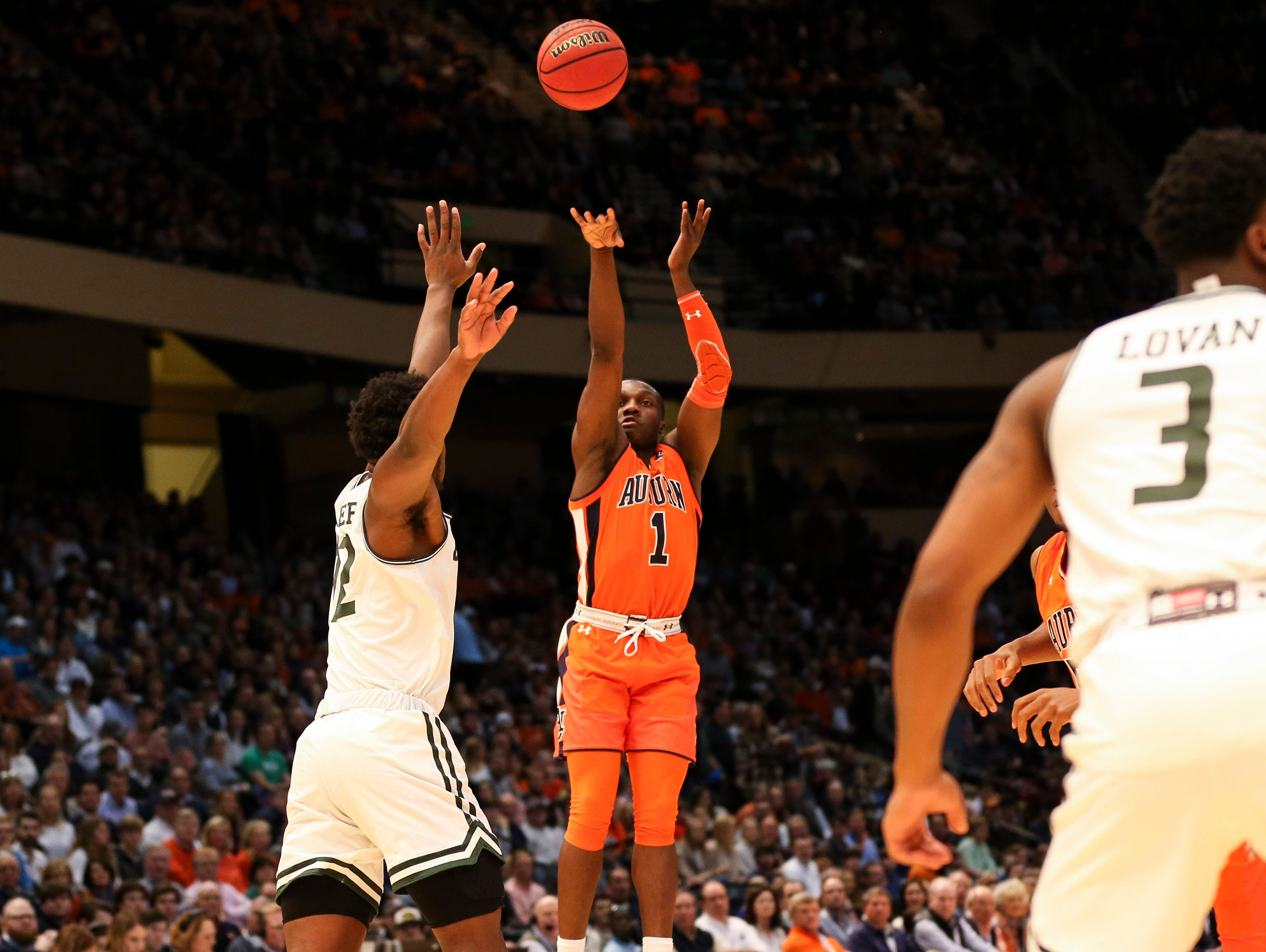 Auburn guard Jared Harper (1) shoots against UAB during the Mike Slive Invitational on Saturday, Dec. 15, 2018, in Birmingham, Ala.