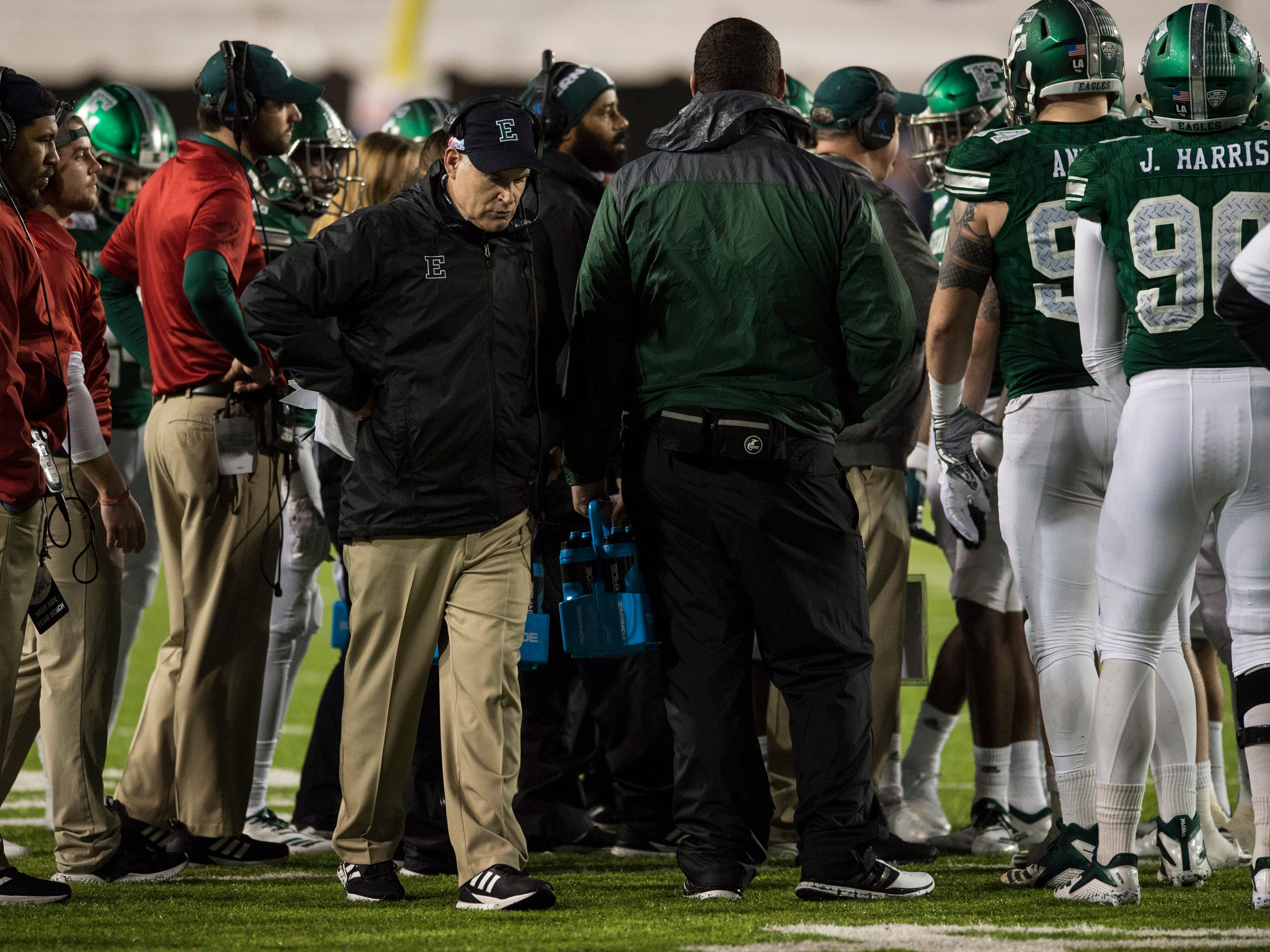 Eastern Michigan head coach Chris Creighton walks around his teams huddle during a timeout during the Camellia Bowl at Cramton Bowl in Montgomery, Ala., on Saturday, Dec. 15, 2018. Georgia Southern defeated Eastern Michigan 23-21.