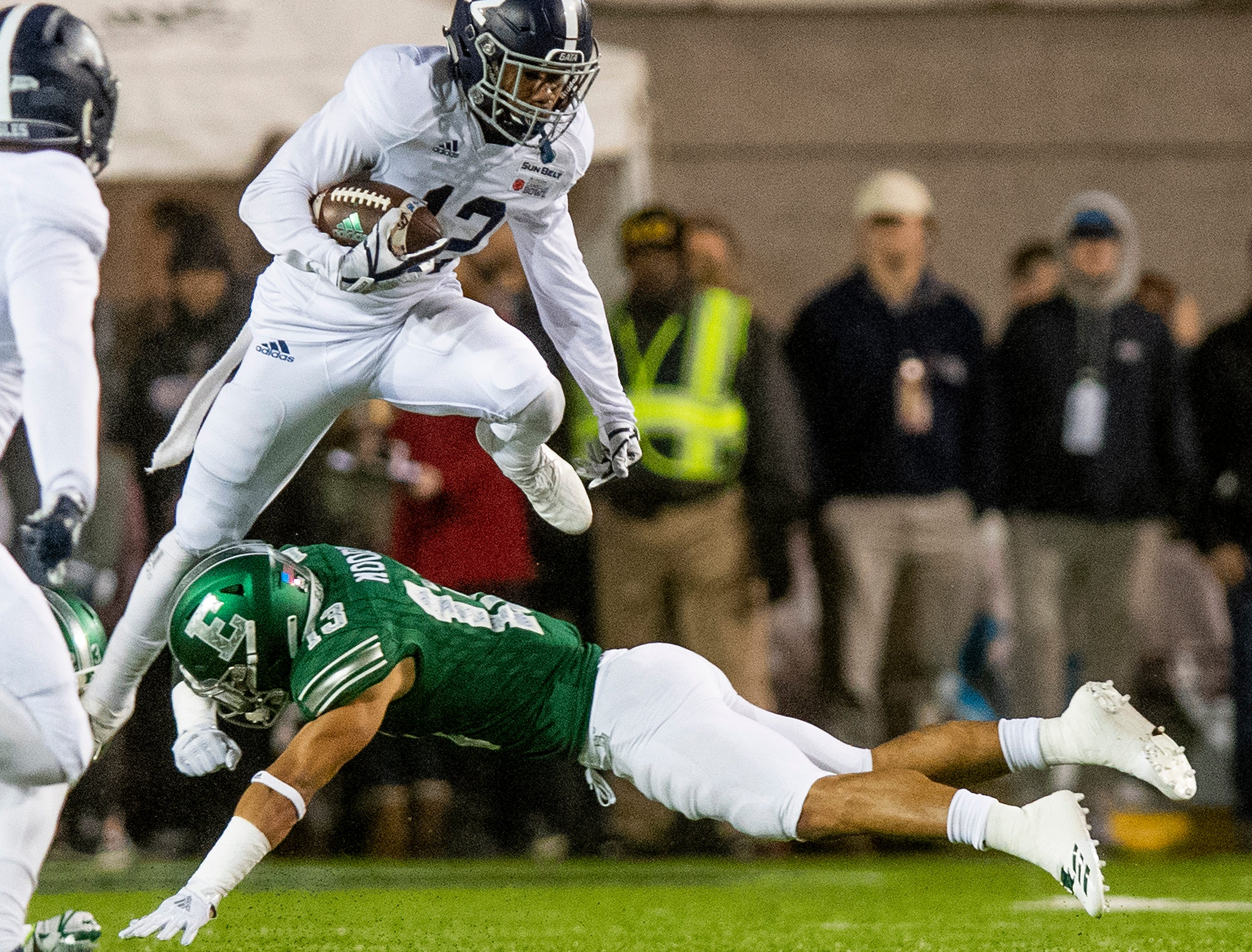 Georgia Southern running back Wesley Kennedy, III, (12) leaps over Eastern Michigan defensive back Justin Moody (13) during first half action in the Raycom Media  Camellia Bowl held at Cramton Bowl in Montgomery, Ala., on Saturday December 15, 2018.