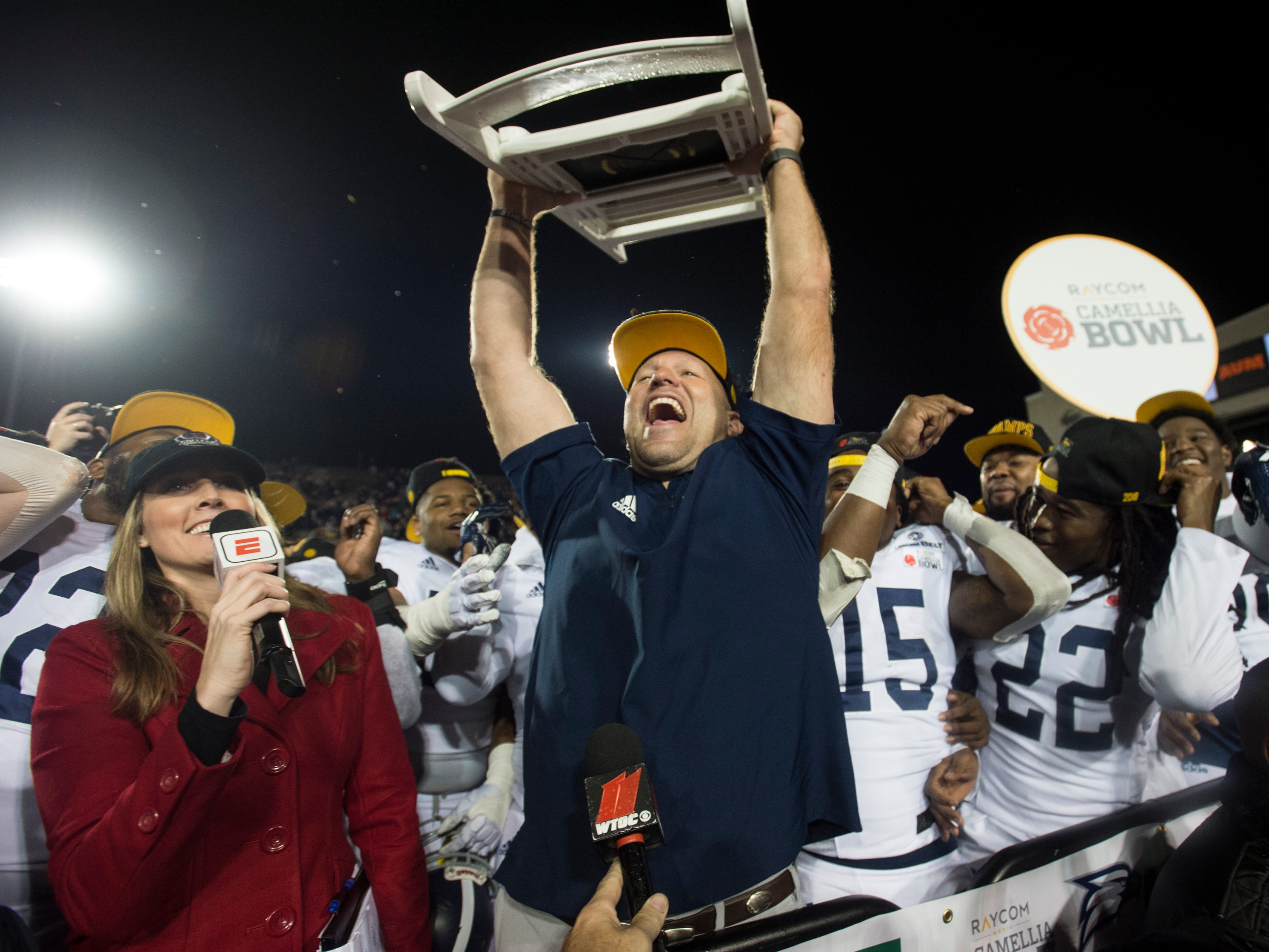 Georgia Southern head coach Chad Lunsford holds up a chair after the Camellia Bowl at Cramton Bowl in Montgomery, Ala., on Saturday, Dec. 15, 2018. Georgia Southern defeated Eastern Michigan 23-21.