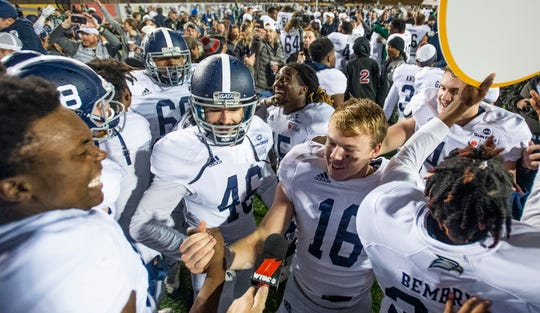 Georgia Southern placekicker Tyler Bass (16) is swarmed by teammates after kicking thew last second game winning field goal against Eastern Michigan in the Raycom Media  Camellia Bowl held at Cramton Bowl in Montgomery, Ala., on Saturday December 15, 2018.