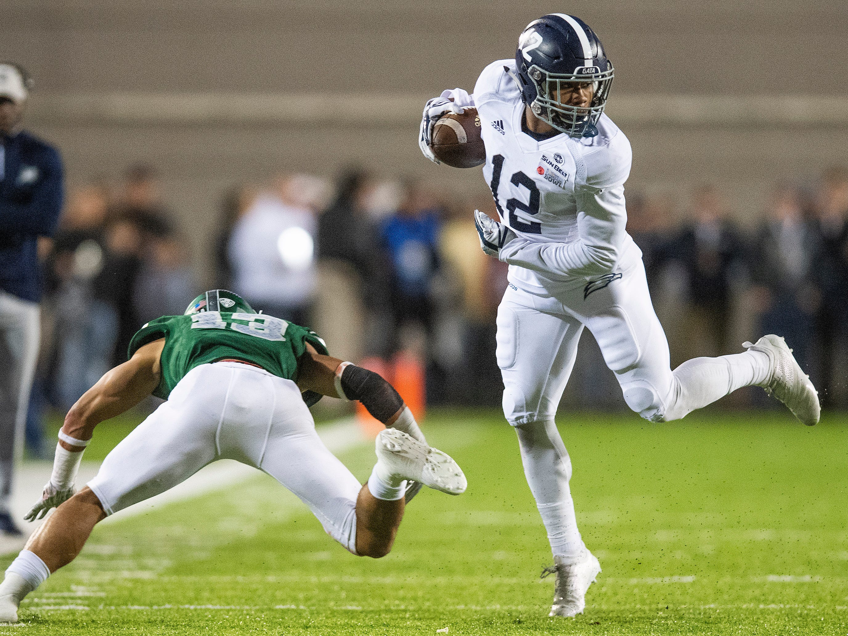 Georgia Southern running back Wesley Kennedy, III, (12) eludes Eastern Michigan defensive back Justin Moody (13) in the Raycom Media  Camellia Bowl held at Cramton Bowl in Montgomery, Ala., on Saturday December 15, 2018.
