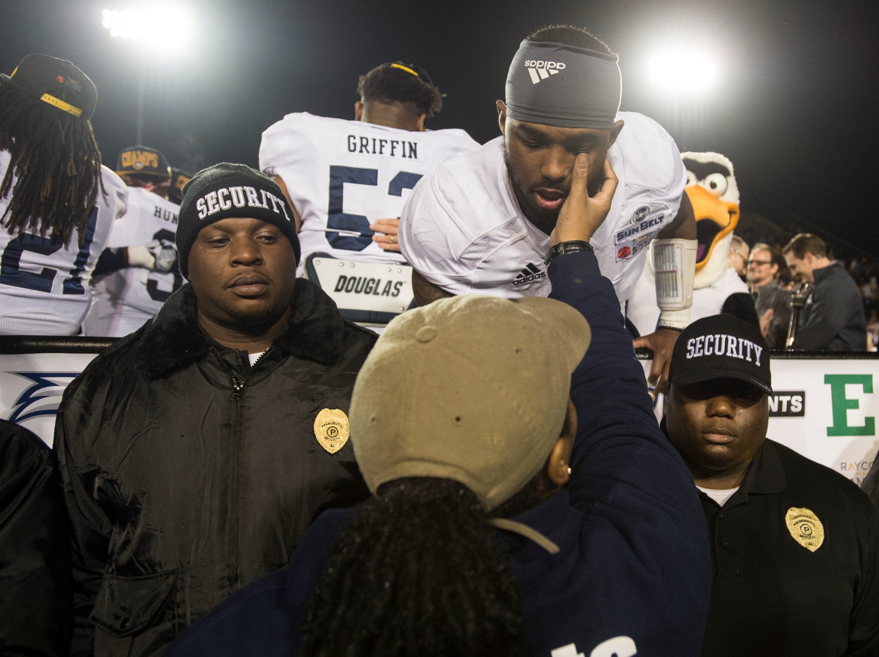 Georgia Southern quarterback Shai Werts (4) celebrates with a family member after winning the Camellia Bowl at Cramton Bowl in Montgomery, Ala., on Saturday, Dec. 15, 2018. Georgia Southern defeated Eastern Michigan 23-21.