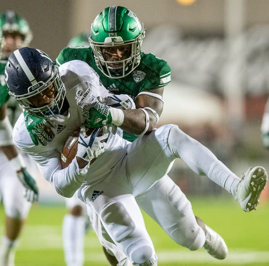 Eastern Michigan defensive back Vince Calhoun (3) wraps up Georgia Southern running back Wesley Kennedy, III, (12) after a long gain during first half action in the Raycom Media  Camellia Bowl held at Cramton Bowl in Montgomery, Ala., on Saturday December 15, 2018.