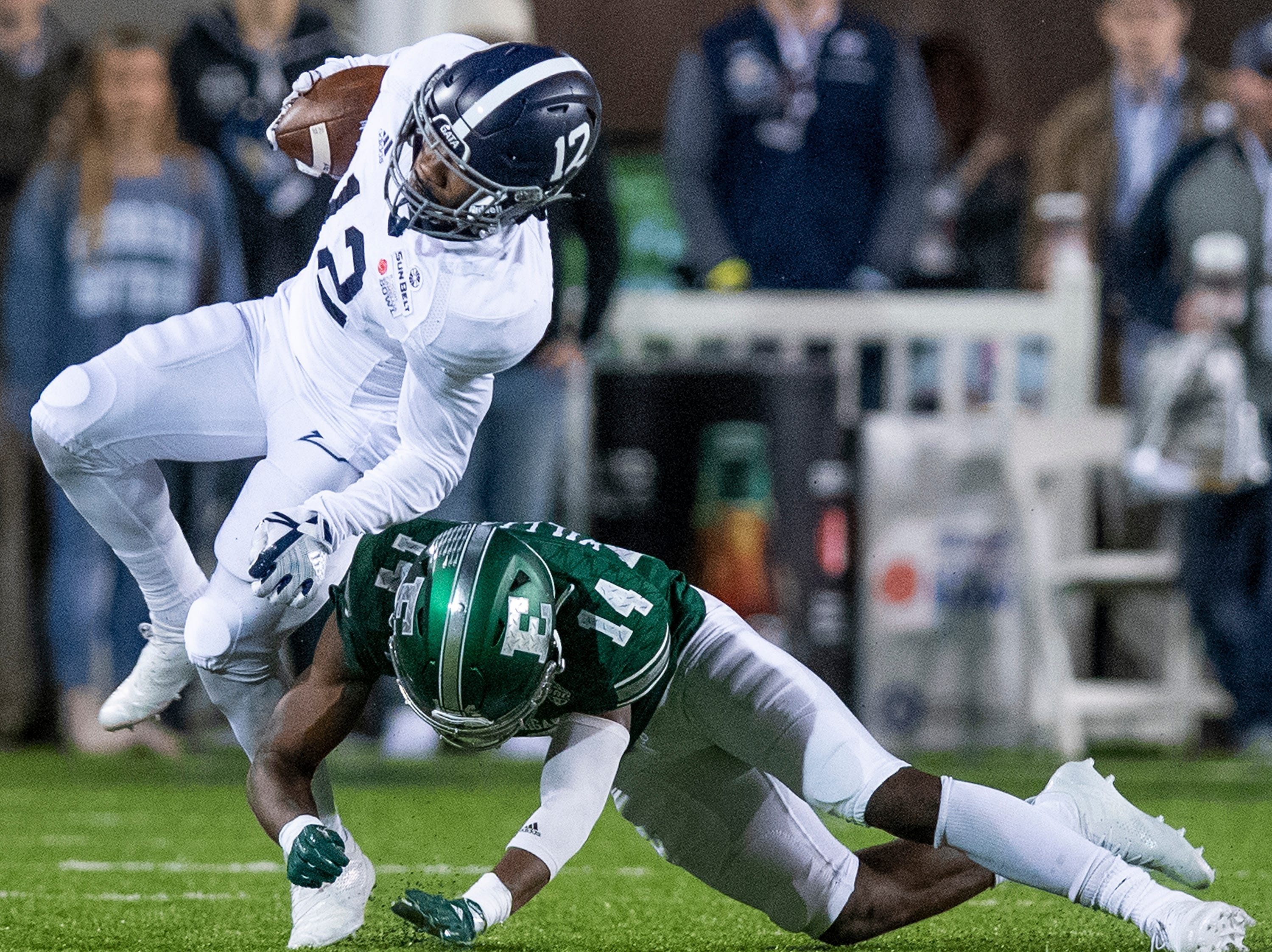 Georgia Southern running back Wesley Kennedy, III, (12) is upended by Eastern Michigan defensive back Ross Williams (14) during first half action in the Raycom Media  Camellia Bowl held at Cramton Bowl in Montgomery, Ala., on Saturday December 15, 2018.