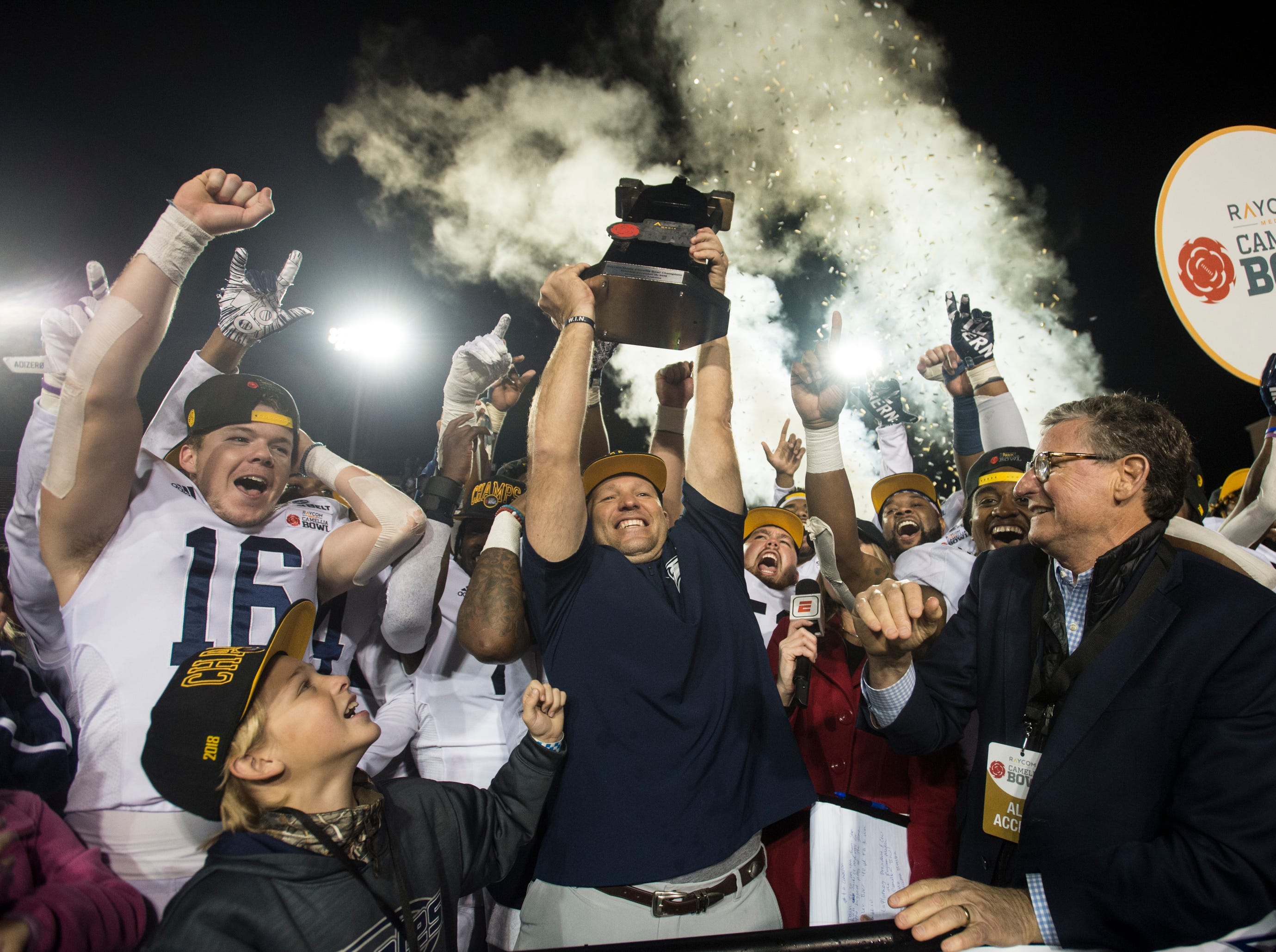 Georgia Southern head coach Chad Lunsford hoists the trophy after winning the Camellia Bowl at Cramton Bowl in Montgomery, Ala., on Saturday, Dec. 15, 2018. Georgia Southern defeated Eastern Michigan 23-21.