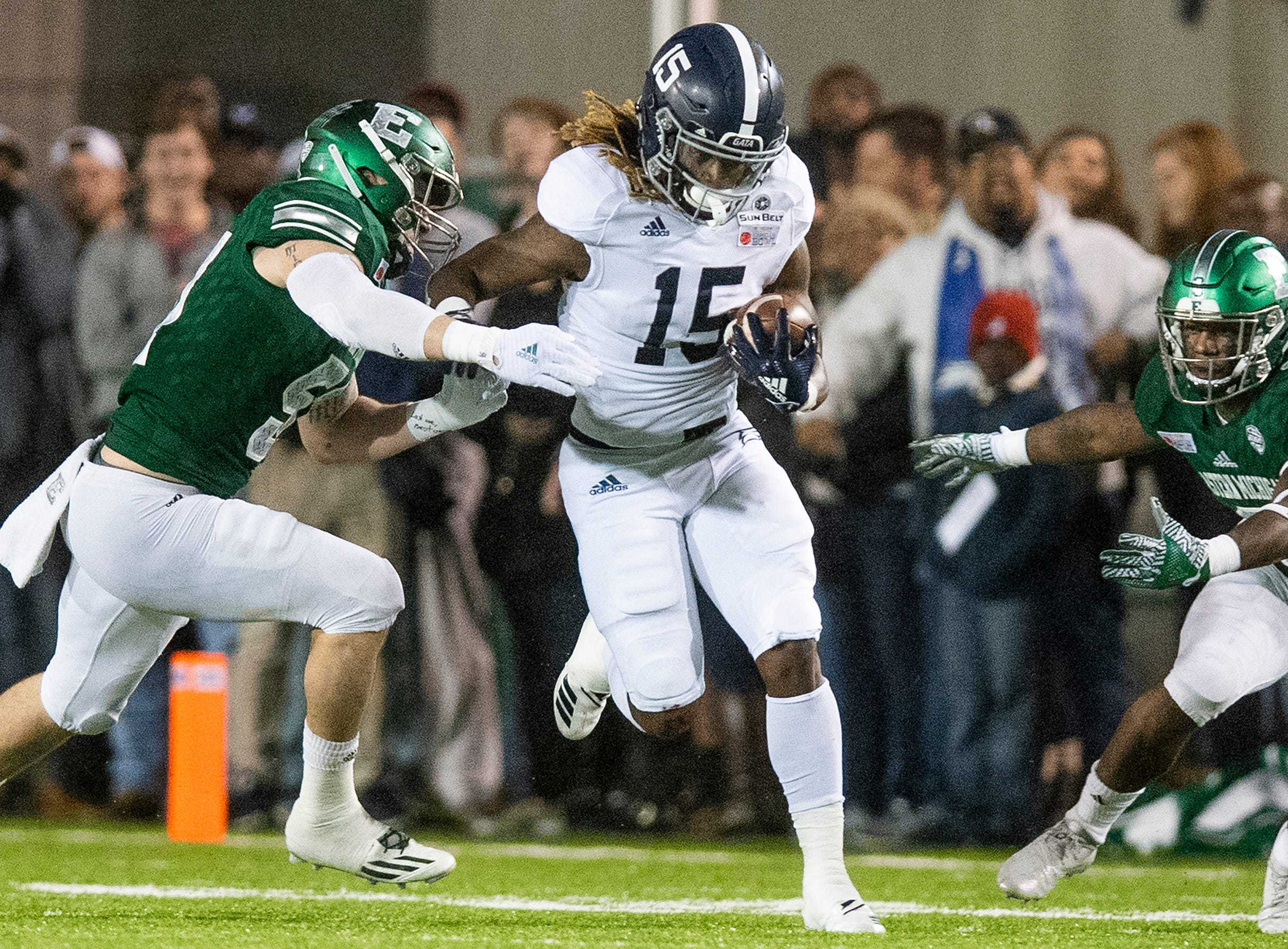 Georgia Southern running back Monteo Garrett (15) carries the ball against Eastern Michigan during first half action in the Raycom Media  Camellia Bowl held at Cramton Bowl in Montgomery, Ala., on Saturday December 15, 2018.