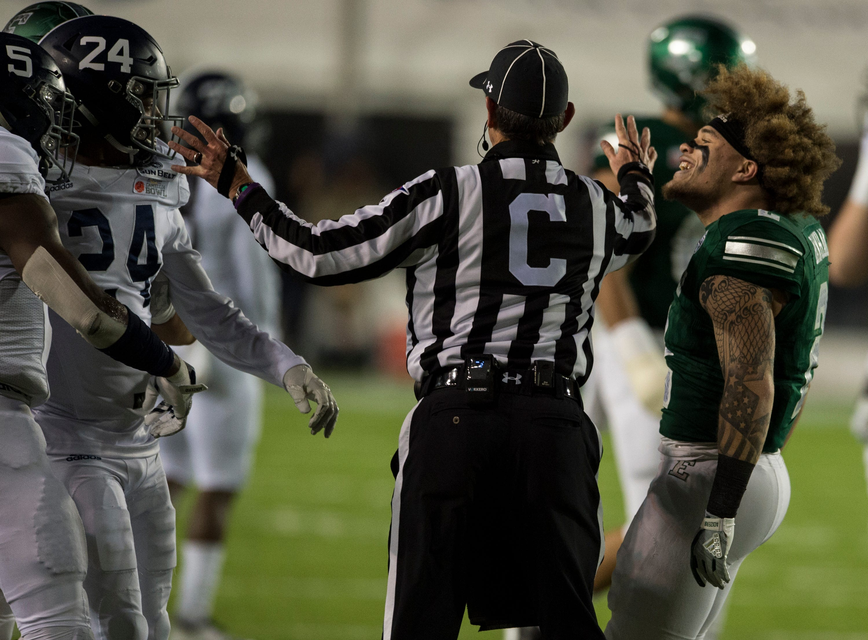 A referee breaks up a shoving match between Georgia Southern safety Jay Bowdry (5) and Eastern Michigan wide receiver Blake Banham (2) during the Camellia Bowl at Cramton Bowl in Montgomery, Ala., on Saturday, Dec. 15, 2018. Georgia Southern leads Eastern Michigan 17-7 at halftime.