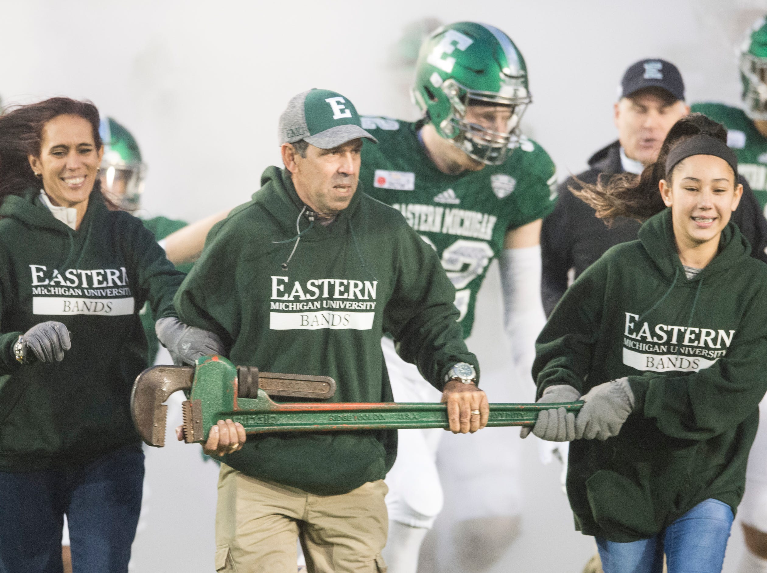 The family of Lazaro Amador, an Eastern Michigan marching band member that died Nov. 8, runs onto the field with the team during the Camellia Bowl at Cramton Bowl in Montgomery, Ala., on Saturday, Dec. 15, 2018. Georgia Southern leads Eastern Michigan 17-7 at halftime.