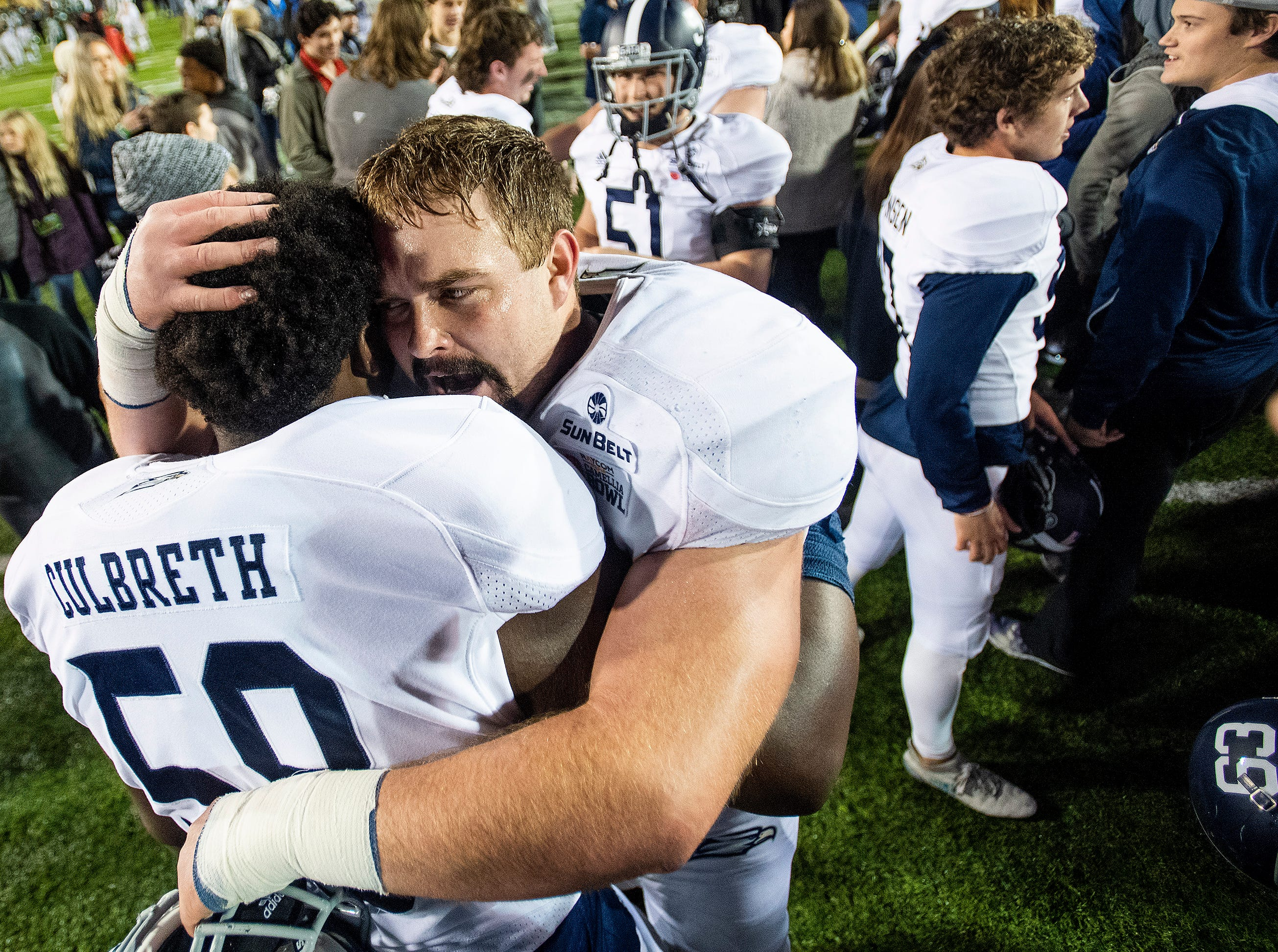 Georgia Southern offensive linemen Jeremiah Culbreth (58)  and Jake Edwards (66) hug after defeating Eastern Michigan in the Raycom Media  Camellia Bowl held at Cramton Bowl in Montgomery, Ala., on Saturday December 15, 2018.