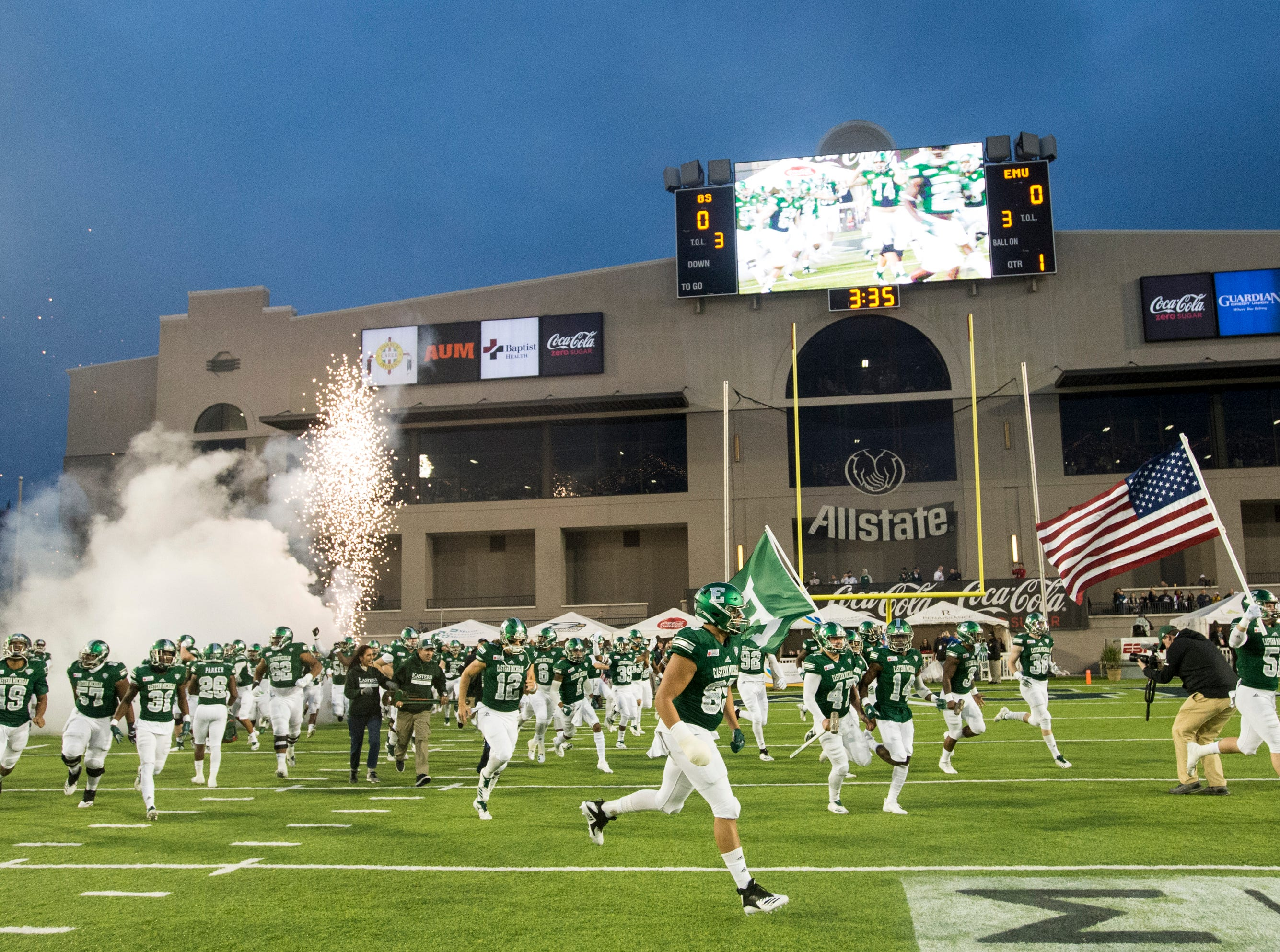 Eastern Michigan's team runs onto the field before the Camellia Bowl at Cramton Bowl in Montgomery, Ala., on Saturday, Dec. 15, 2018. Georgia Southern leads Eastern Michigan 17-7 at halftime.