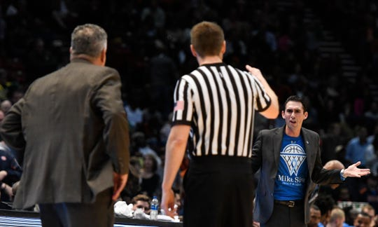 Auburn head coach Bruce Pearl, left, and UAB head coach Robert Ehsan, back right, argue with in official before the start of overtime on Saturday, Dec. 15, 2018, in Birmingham, Ala.